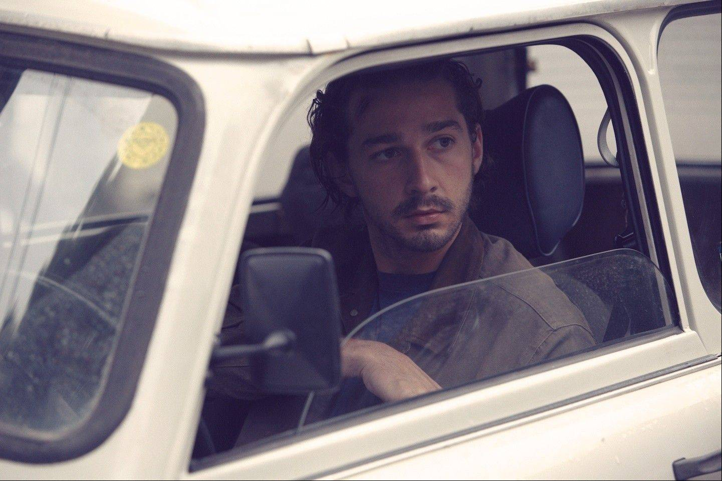 "Shia LaBeouf stars as ""Charlie Countryman,"" except this scene doesn't have Dann's name and a running digital clock at the bottom of the frame."