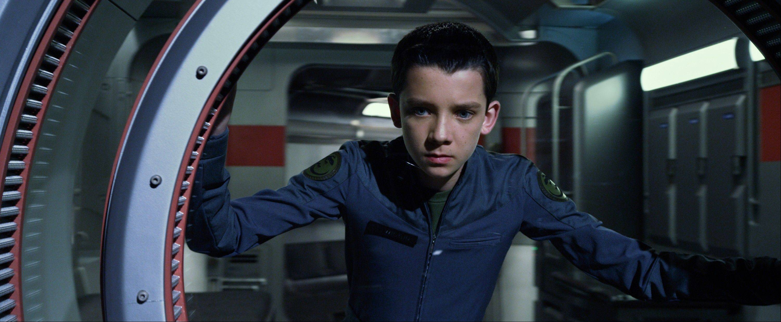 "A young man named Ender (the charismatic Asa Butterfield) enrolls in Battle School to save his planet in ""Ender's Game."""