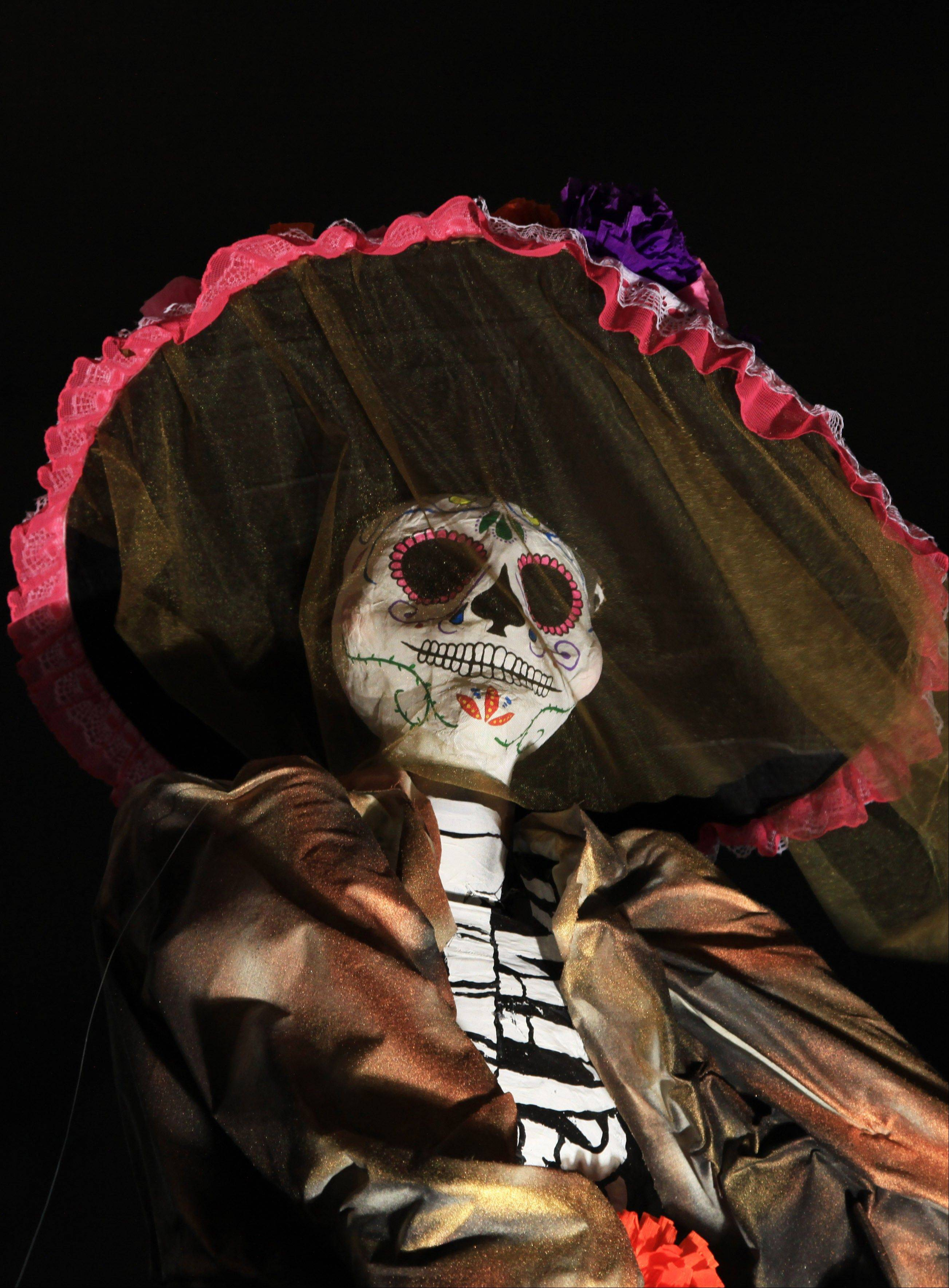 "A traditional Mexican ""Catrina"" sits at Mexico's National Autonomous University during Day of the Dead celebrations in Mexico City Wednesday."