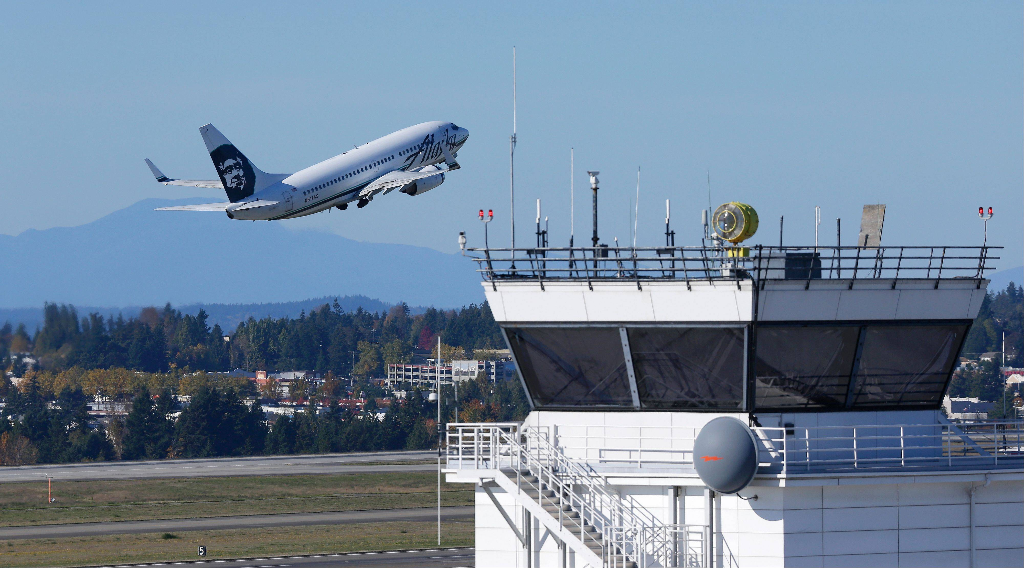 An Alaska Airlines plane takes off Monday from Seattle-Tacoma International Airport. The modernization of the U.S. air traffic control system, one of the government's most ambitious and complex technology programs, is in trouble.