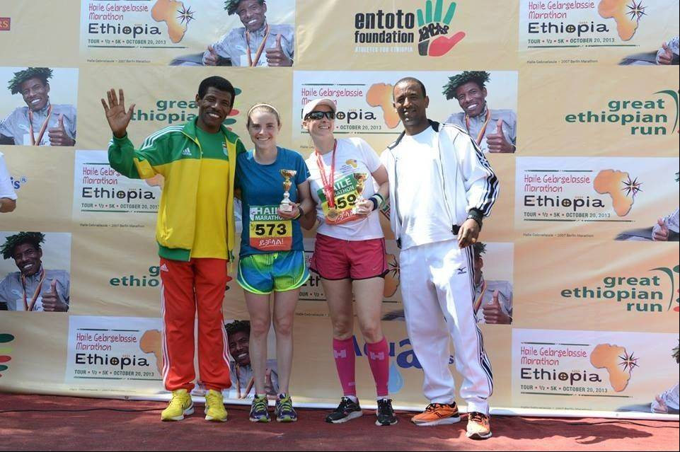 Megan McClowry, 25, of Naperville, second from left, poses after winning the women's division of foreign runners during the first Haile Gebreselassie Marathon in southern Ethiopia. She currently works as a nurse in Uganda.