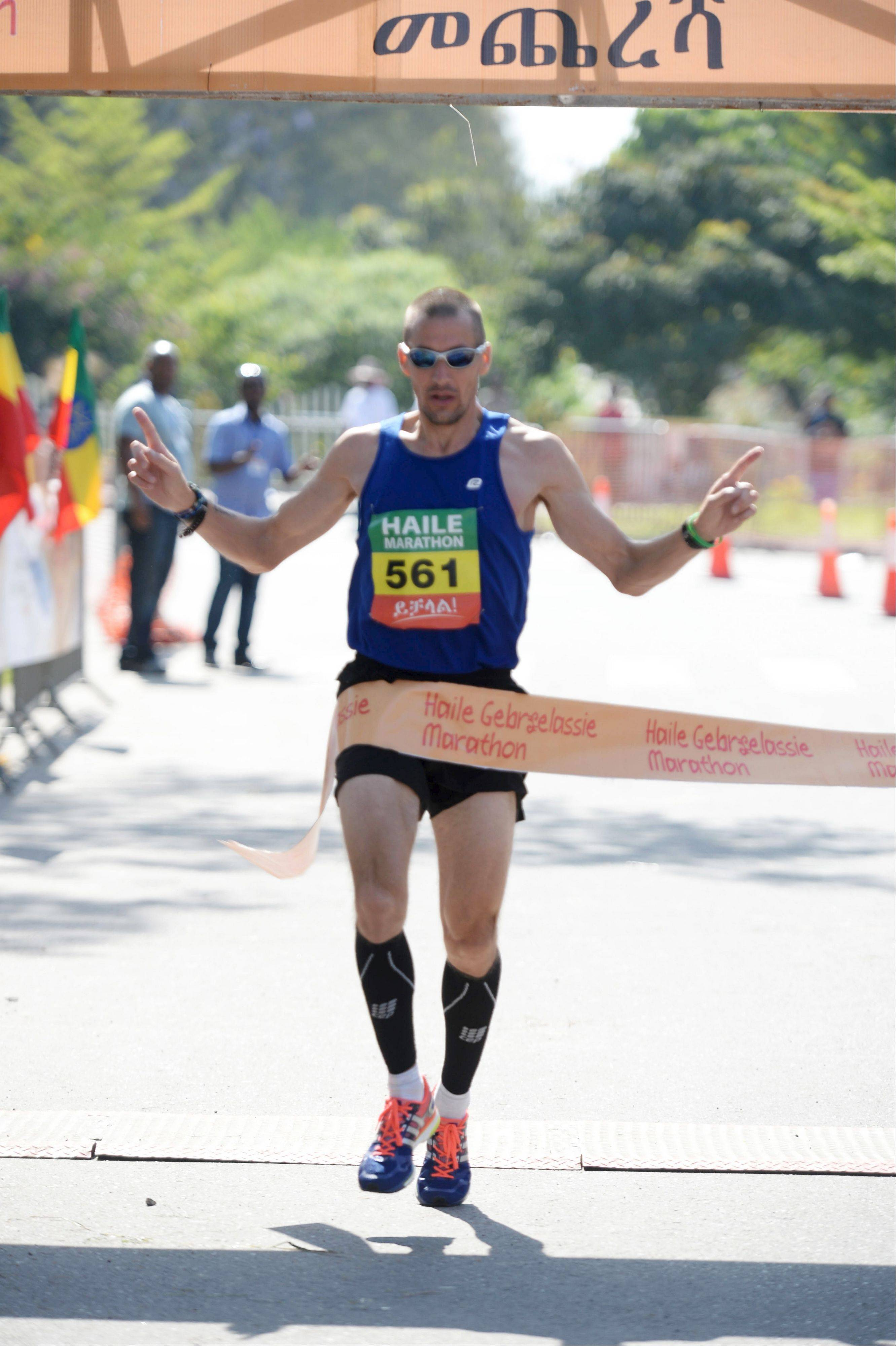 Jason Doland, of Inverness, crosses the finish line at the inaugural Haile Gebrselassie Marathon Oct. 20 in Ethiopia.
