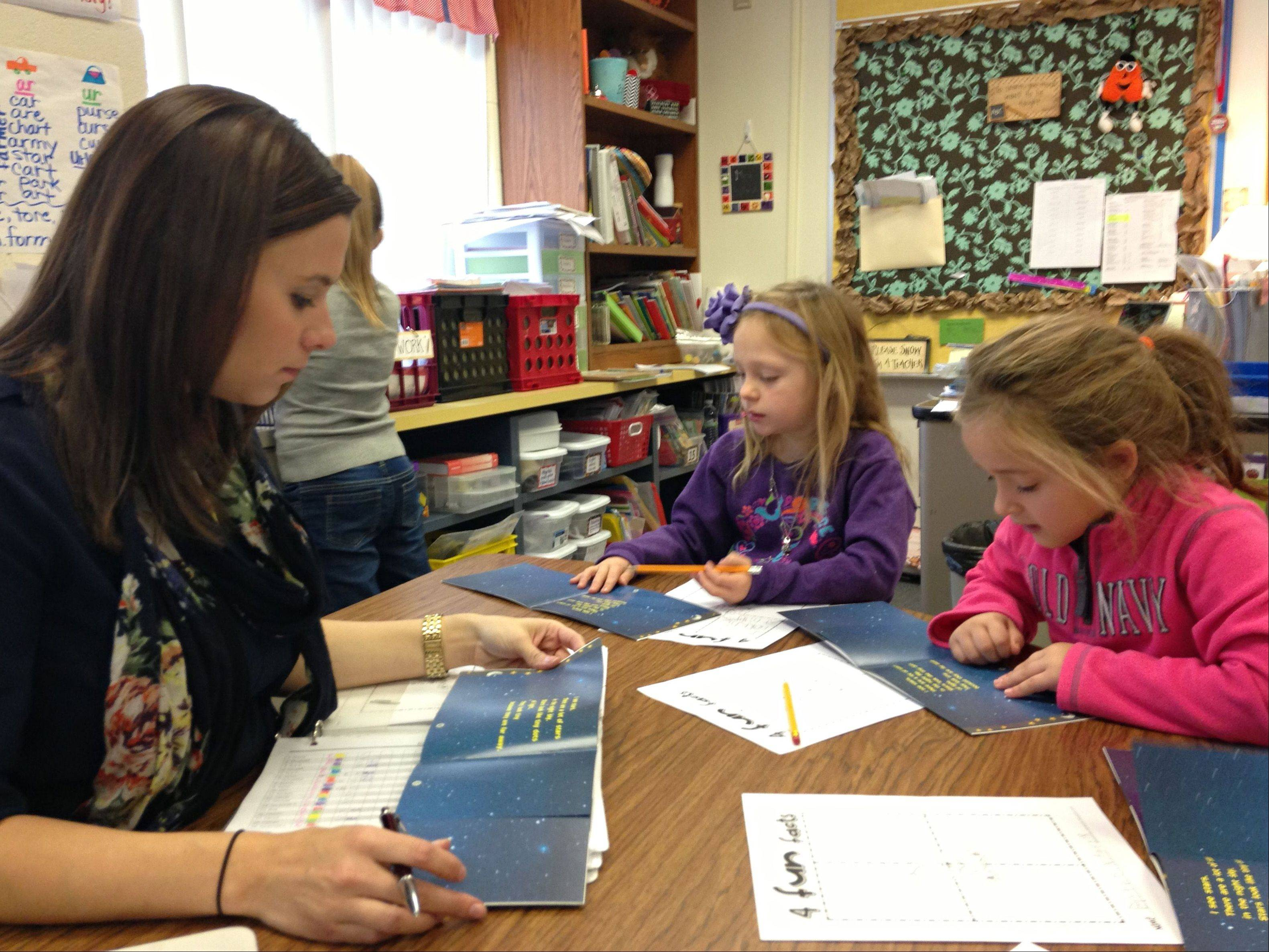 "First-grade teacher Diana Silva conducts a guided-reading session with several of her students, including Samantha Malo, left, and Payton Wald, during the ""power half-hour"" of literacy work at Kaneland John Stewart Elementary School in Elburn."