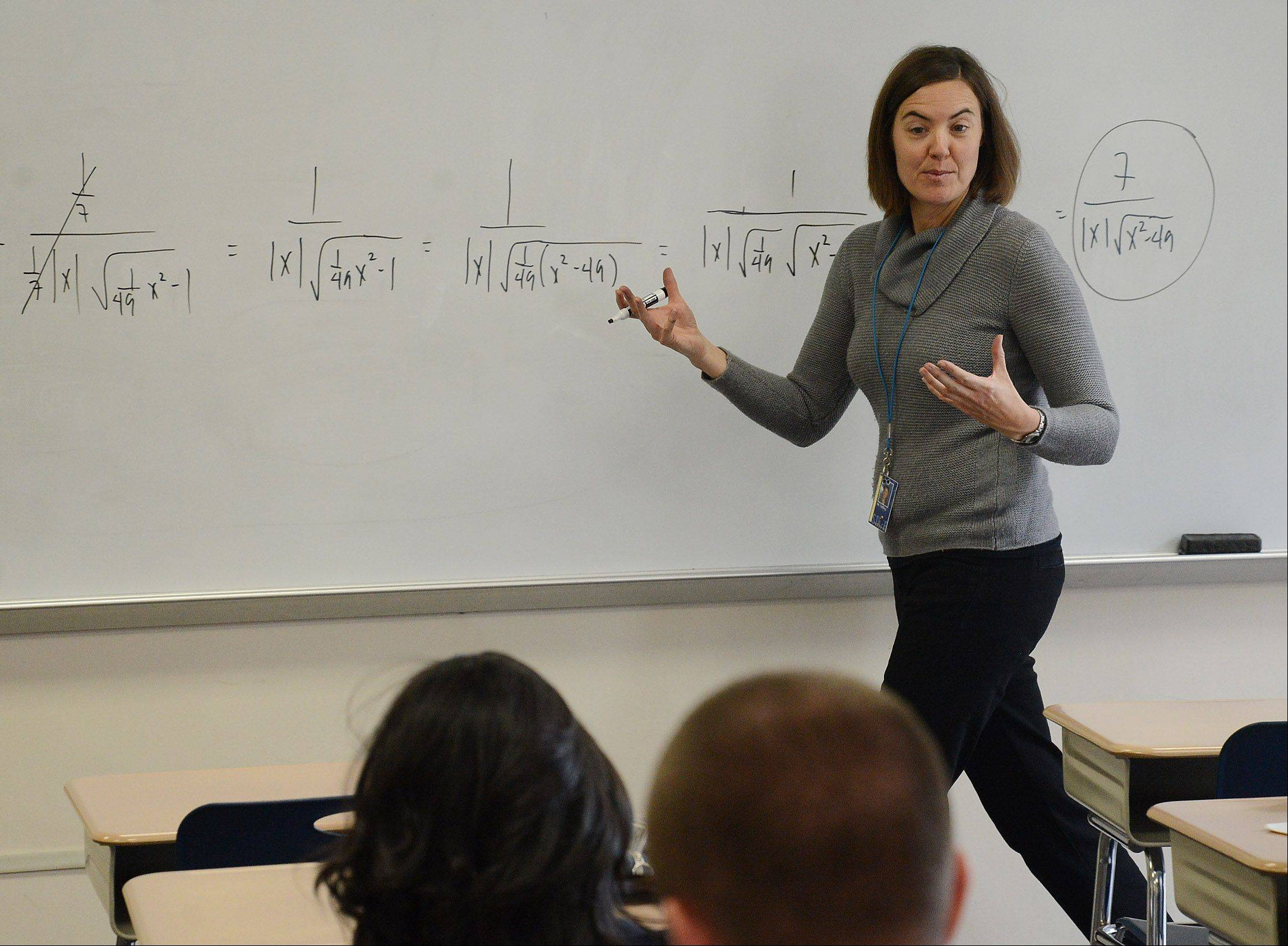 Calculus teacher Laura Oeffling leads her class at Warren Township High School's Almond Road campus in Gurnee for juniors and seniors. Warren improved its Prairie State Achievement Exam composite score on this year's state report card.