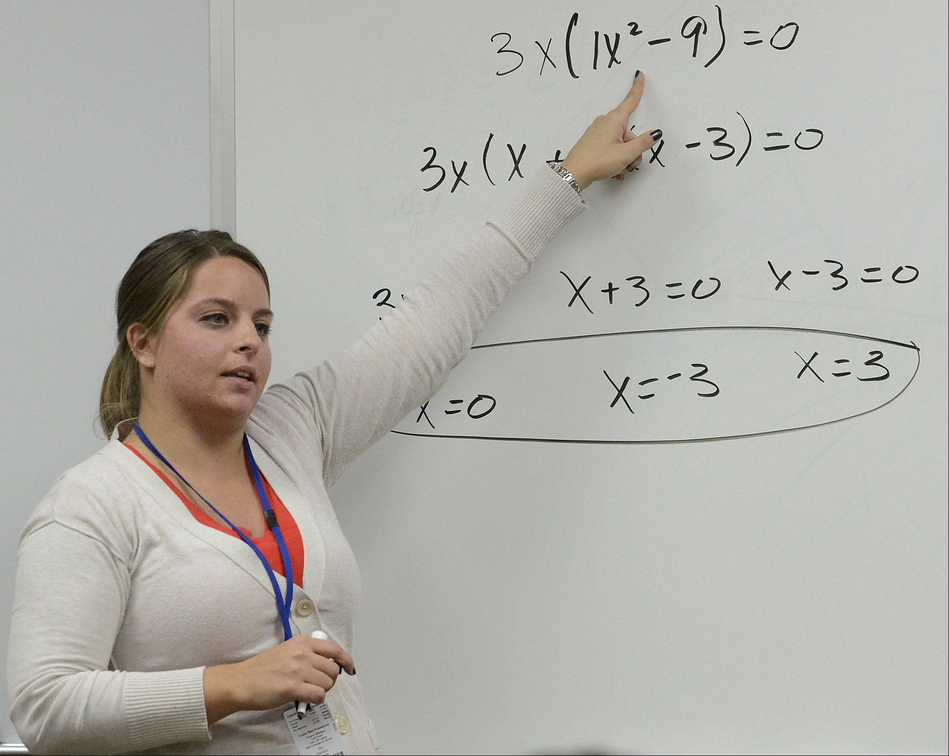 Algebra II Trigonometry instructor Alison Nardini goes over material at Warren Township High School's junior-senior campus in Gurnee. Superintendent Mary Perry Bates says a new way that subject is taught -- called a flipped classroom, which gives more responsibility to students -- is helping boost Warren's academics.