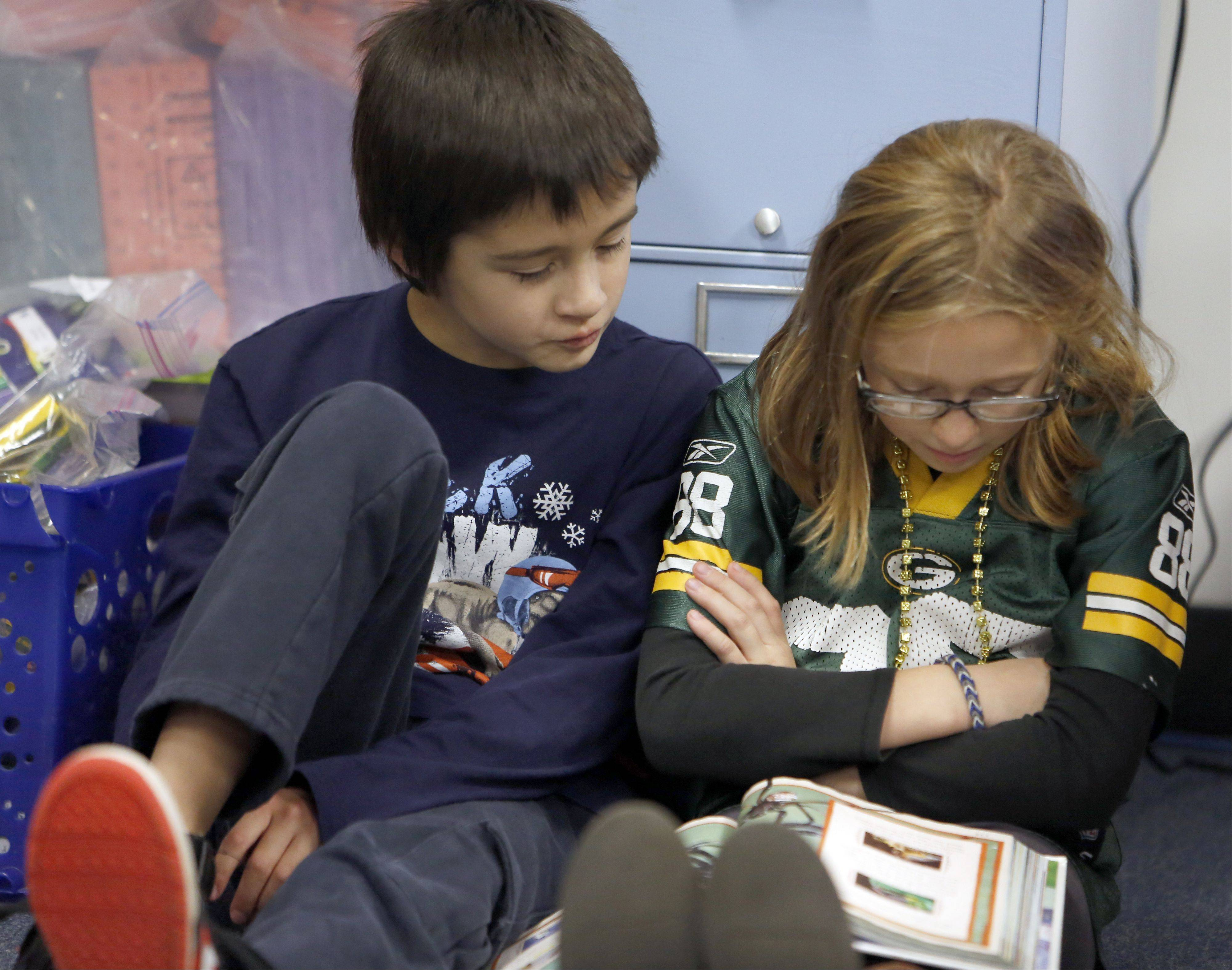 Marco Conti and Mia Clemons, both 8, practice reading at Algonquin Road School in Fox River Grove.