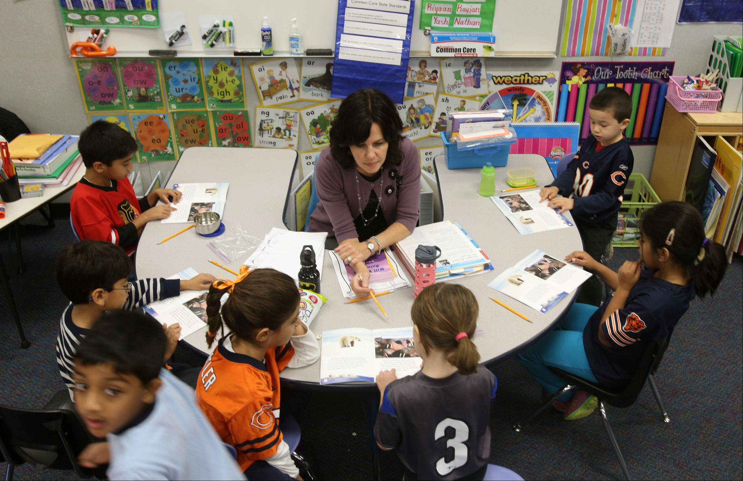 First-grade teacher Patti Meyer works with students at Brook Forest Elementary in Oak Brook, where 94.4 percent of students met or exceeded standards on the Illinois Standards Achievement Test taken this spring.