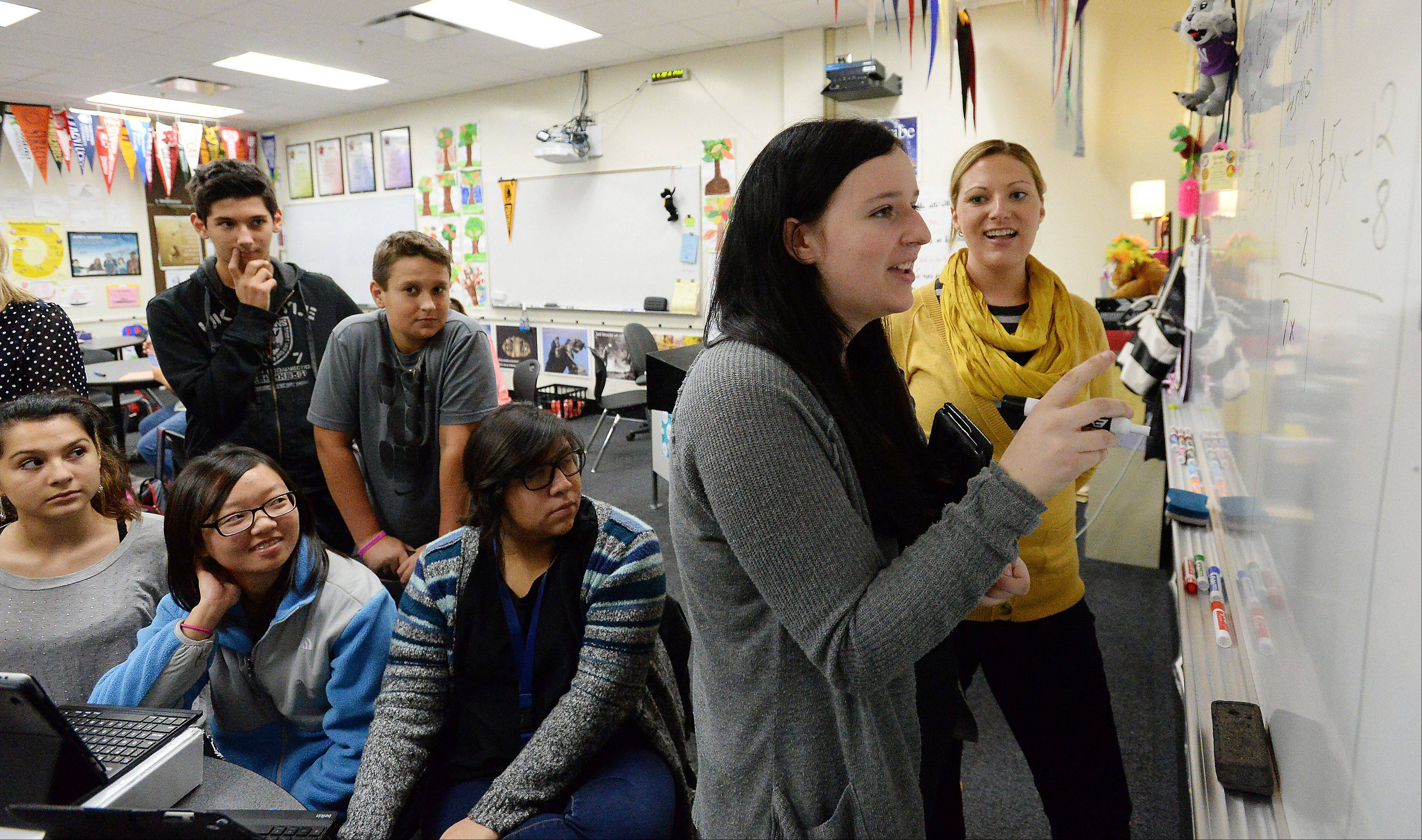 Kennedy Carlson, 15, works with teacher Michelle Marconi in the Advancement Via Individual Determination classroom at Rolling Meadows High School. The class gives extra help to students who would be the first in the family to go to college.