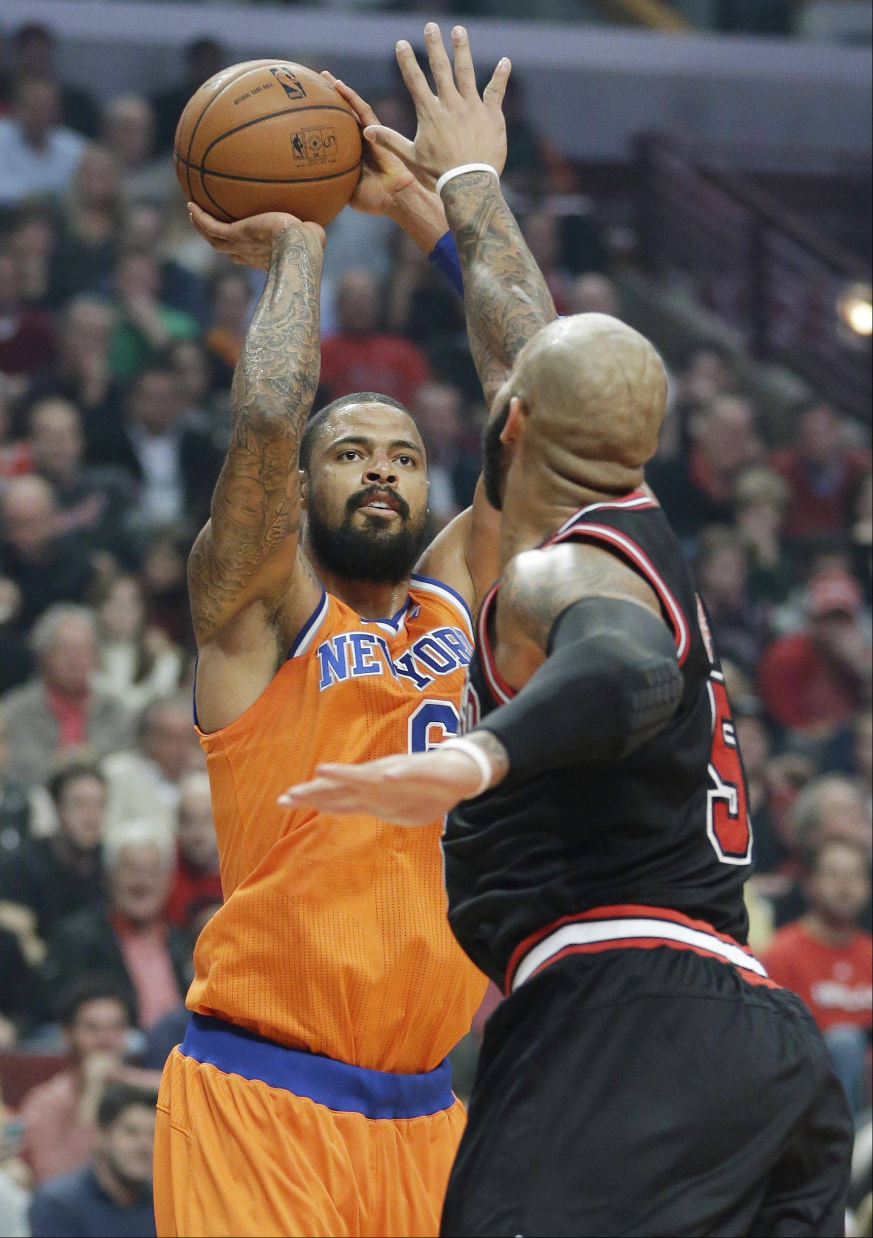 New York Knicks center Tyson Chandler, left, shoots over Chicago Bulls forward Carlos Boozer during the first half.