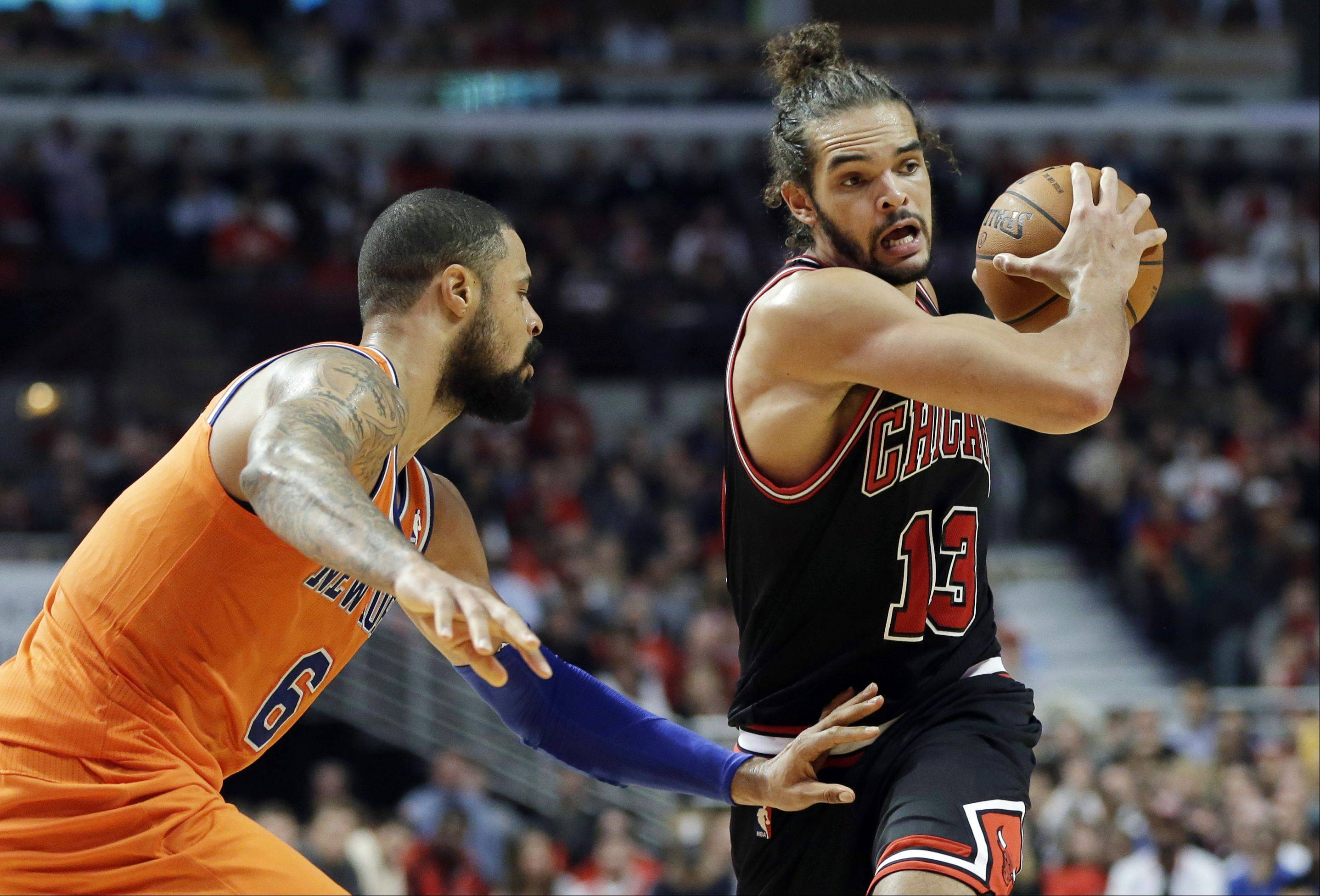 Chicago Bulls center Joakim Noah, right, looks to pass as New York Knicks center Tyson Chandler guards during the second half.