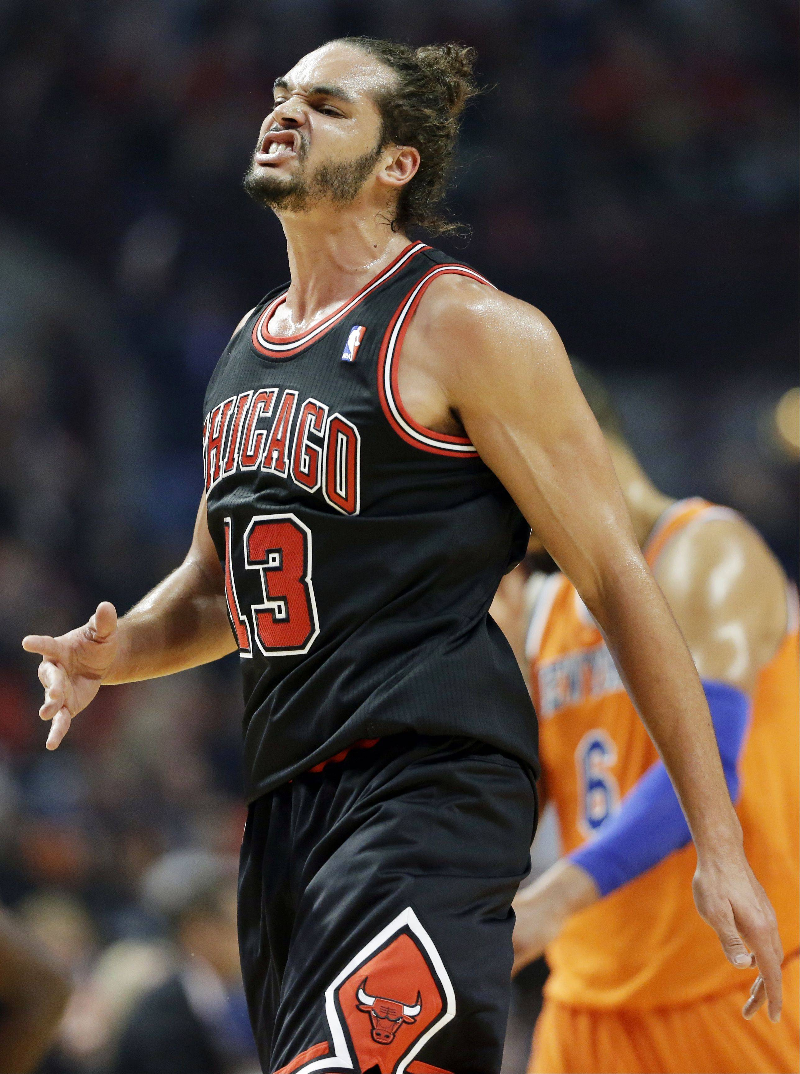 Chicago Bulls center Joakim Noah reacts after Derrick Rose scored a basket during the first half of an NBA basketball game against the New York Knicks.