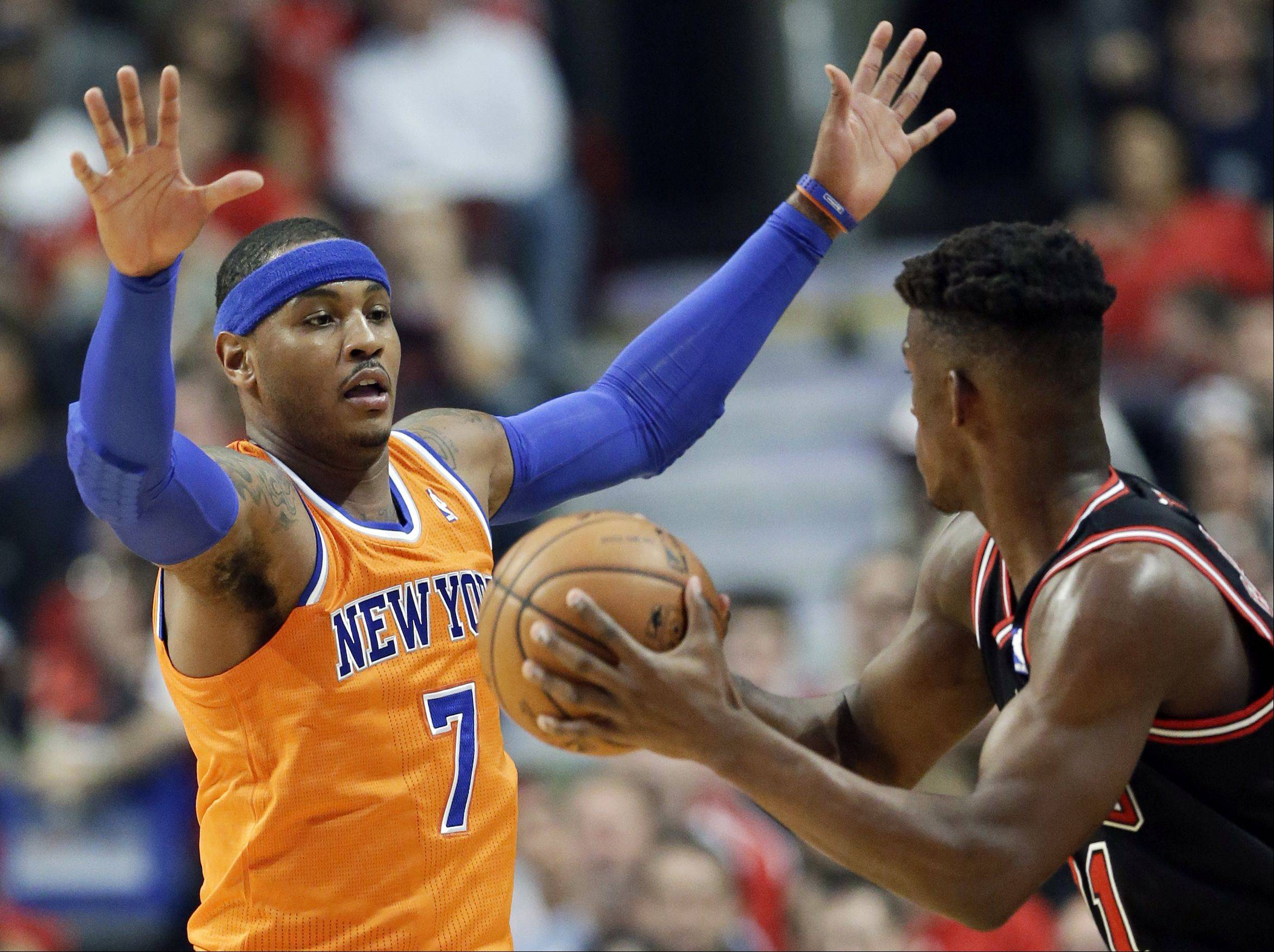 New York Knicks forward Carmelo Anthony, left, guards Chicago Bulls forward Jimmy Butler during the first half.