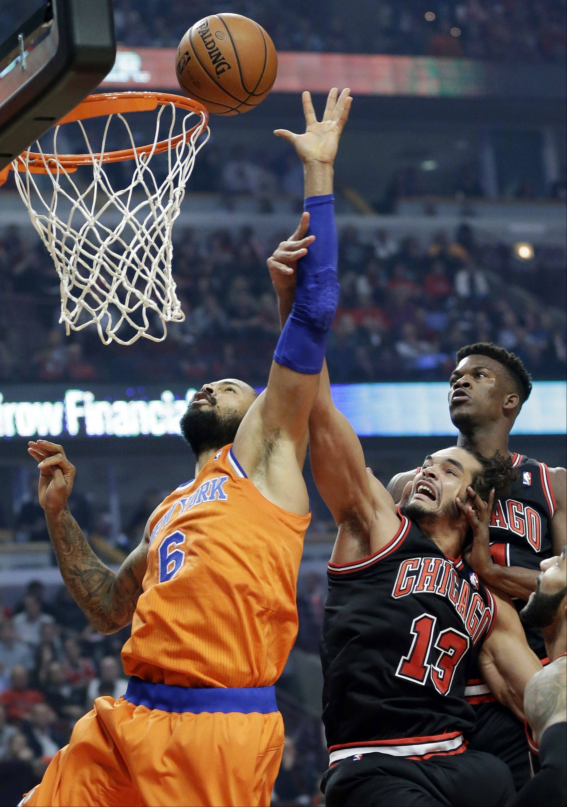 New York Knicks center Tyson Chandler (6) battles for a rebound against Chicago Bulls center Joakim Noah (13) and forward Jimmy Butler during the first half.