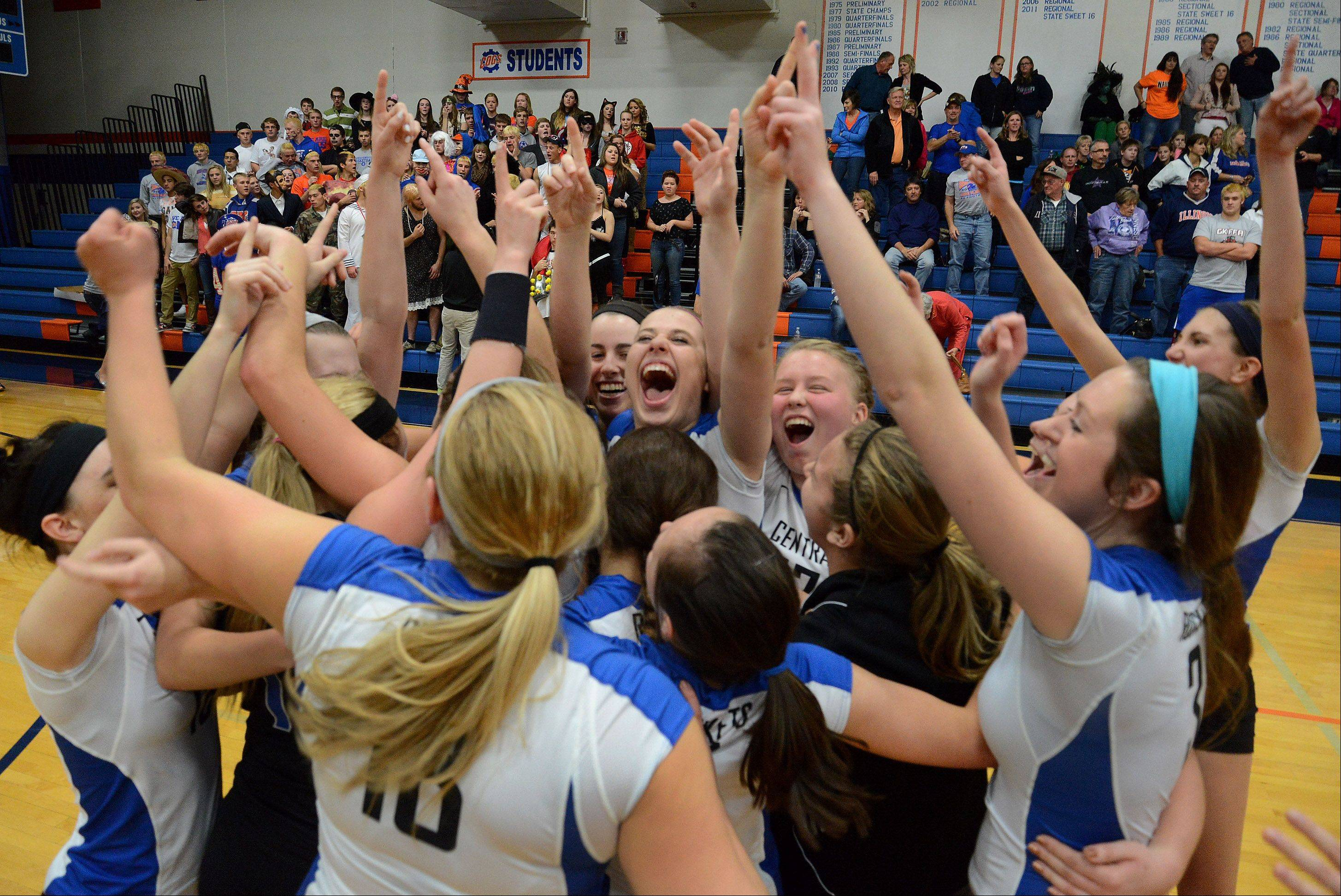 Burlington Central celebrates after defeating Genoa-Kingston for the Class 3A Genoa volleyball regional title Thursday night.