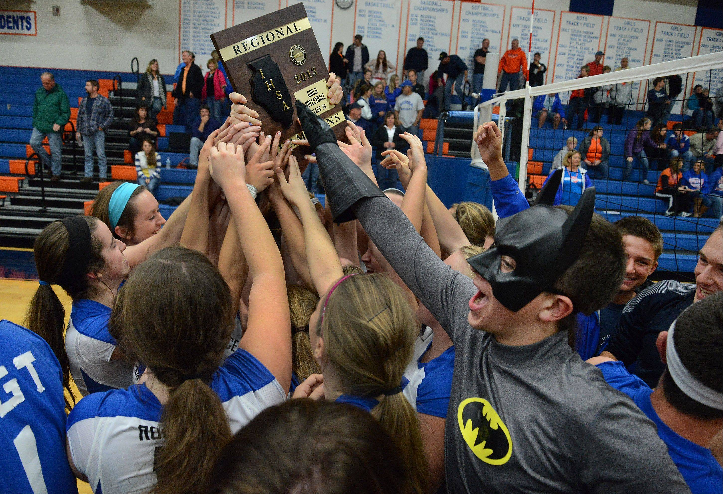 Burlington Central celebrates with fans after defeating Genoa-Kingston for Class 3A volleyball regional title.