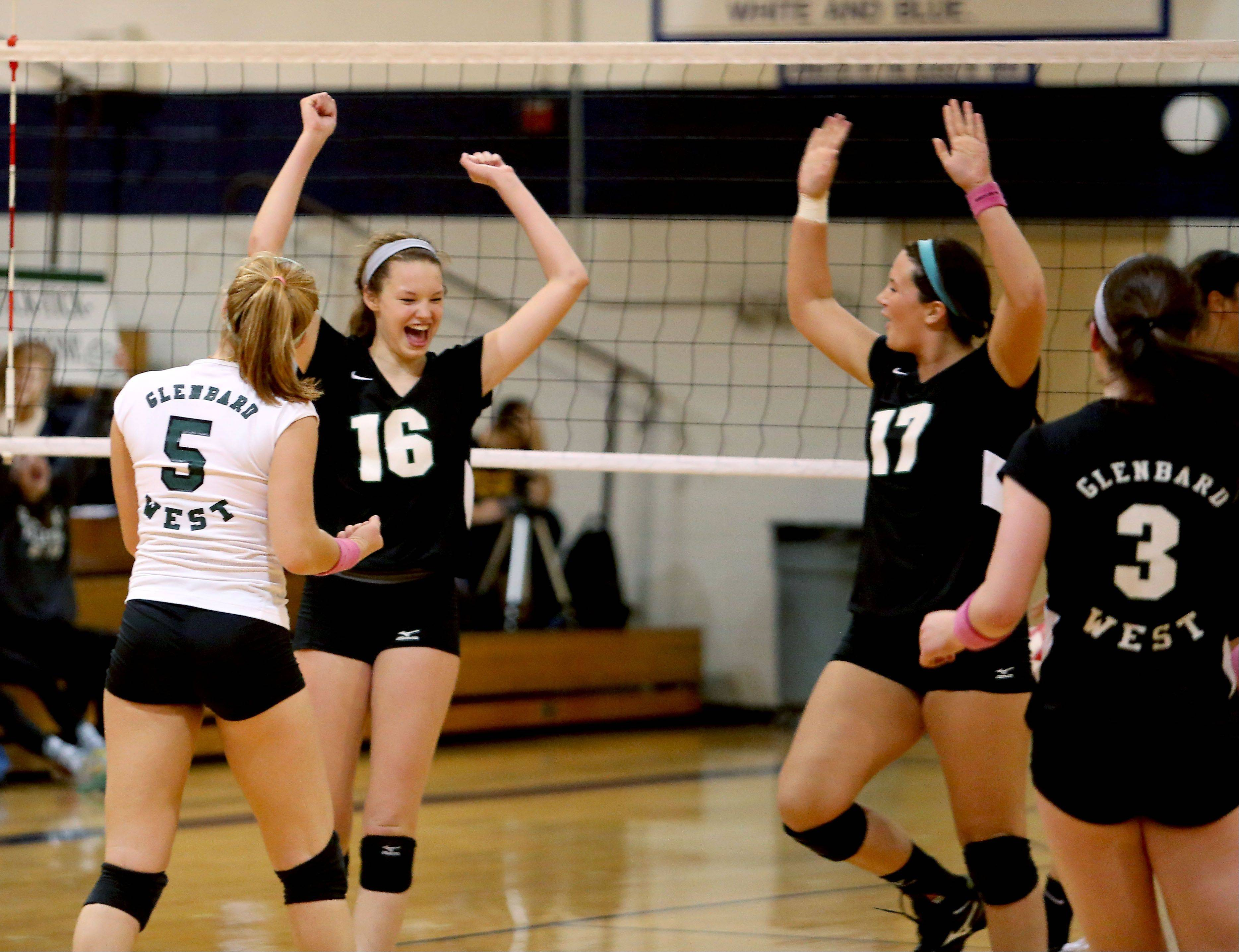 Glenbard West celebrate a point won over Schaumburg during their 2-0 win in the Class 4A regional volleyball final in West Chicago on Thursday.