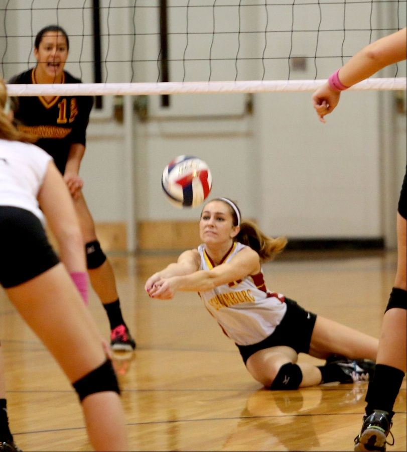 Sarah Stuehm of Schaumburg dives for a ball in action against Glenbard West during the Class 4A regional volleyball final in West Chicago on Thursday.