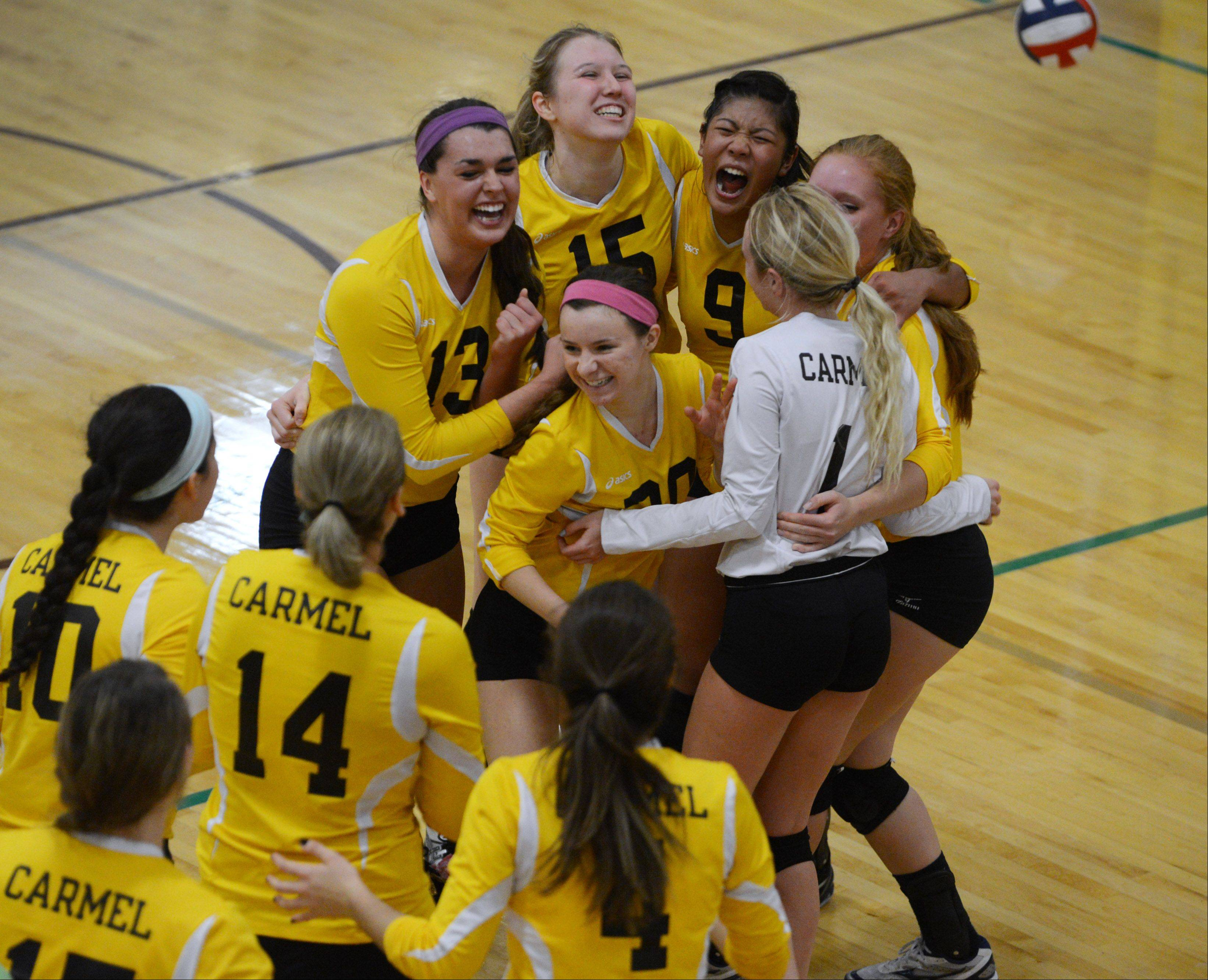 Carmel players celebrate their Class 4A regional final win over Glenbrook South on Thursday in Mundelein.