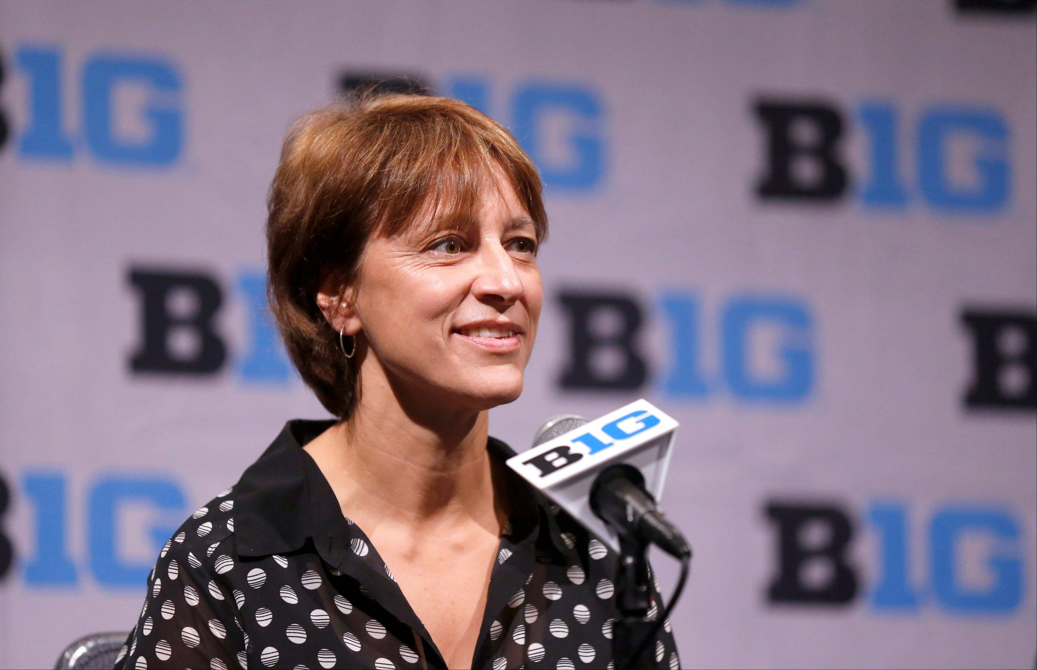 Nebraska women's basketball coach Connie Yori listens to a question during the Big Ten's basketball media day on Thursday in Rosemont. The Cornhuskers return four starters this season.