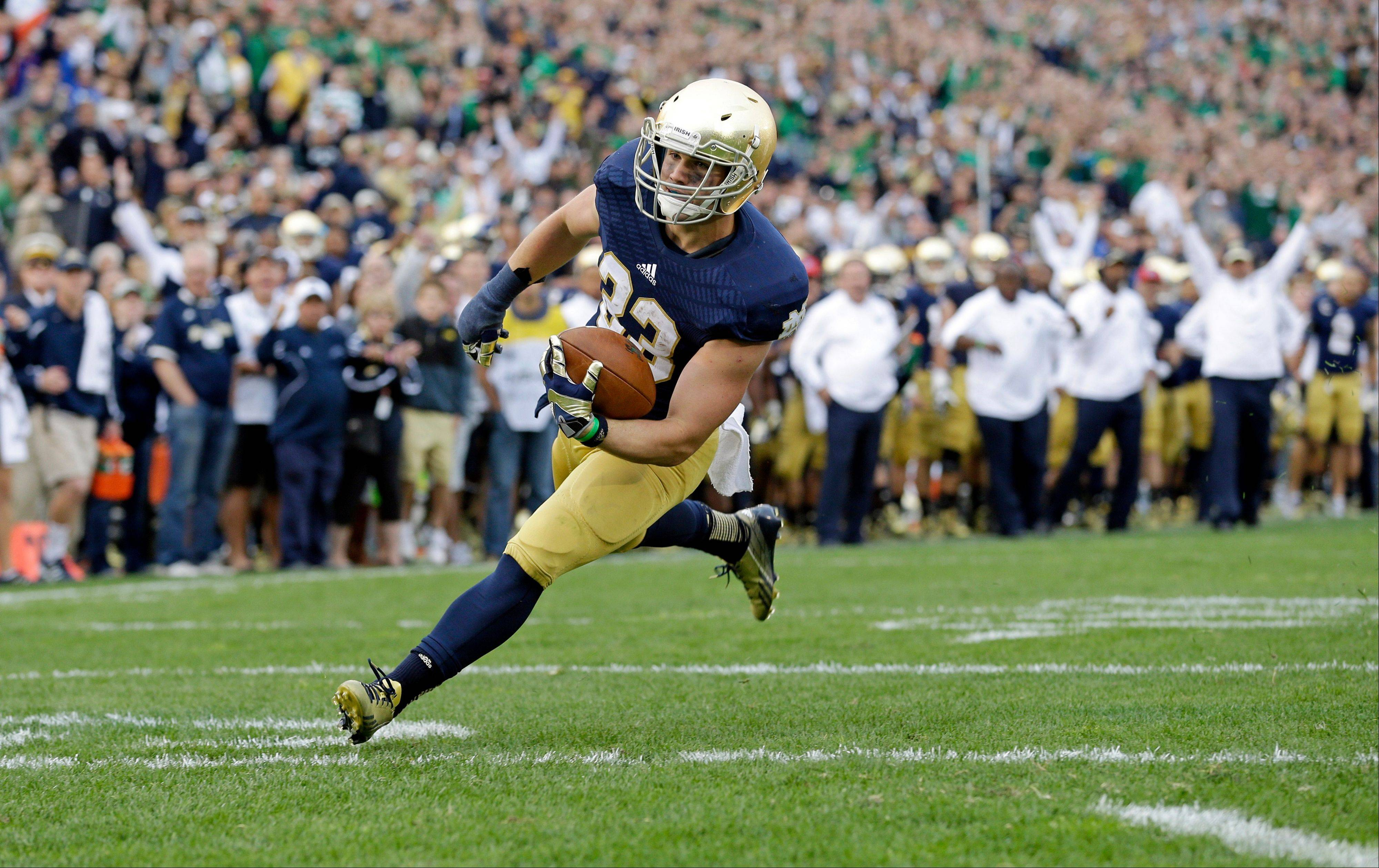 Notre Dame running back Cam McDaniel scores a touchdown against Michigan State during the second half of the Sept. 21 game in South Bend, Ind. The 5-10, 207-pound junior from Coppell, Texas, was given the ball on 12 of the final 16 plays of the game.