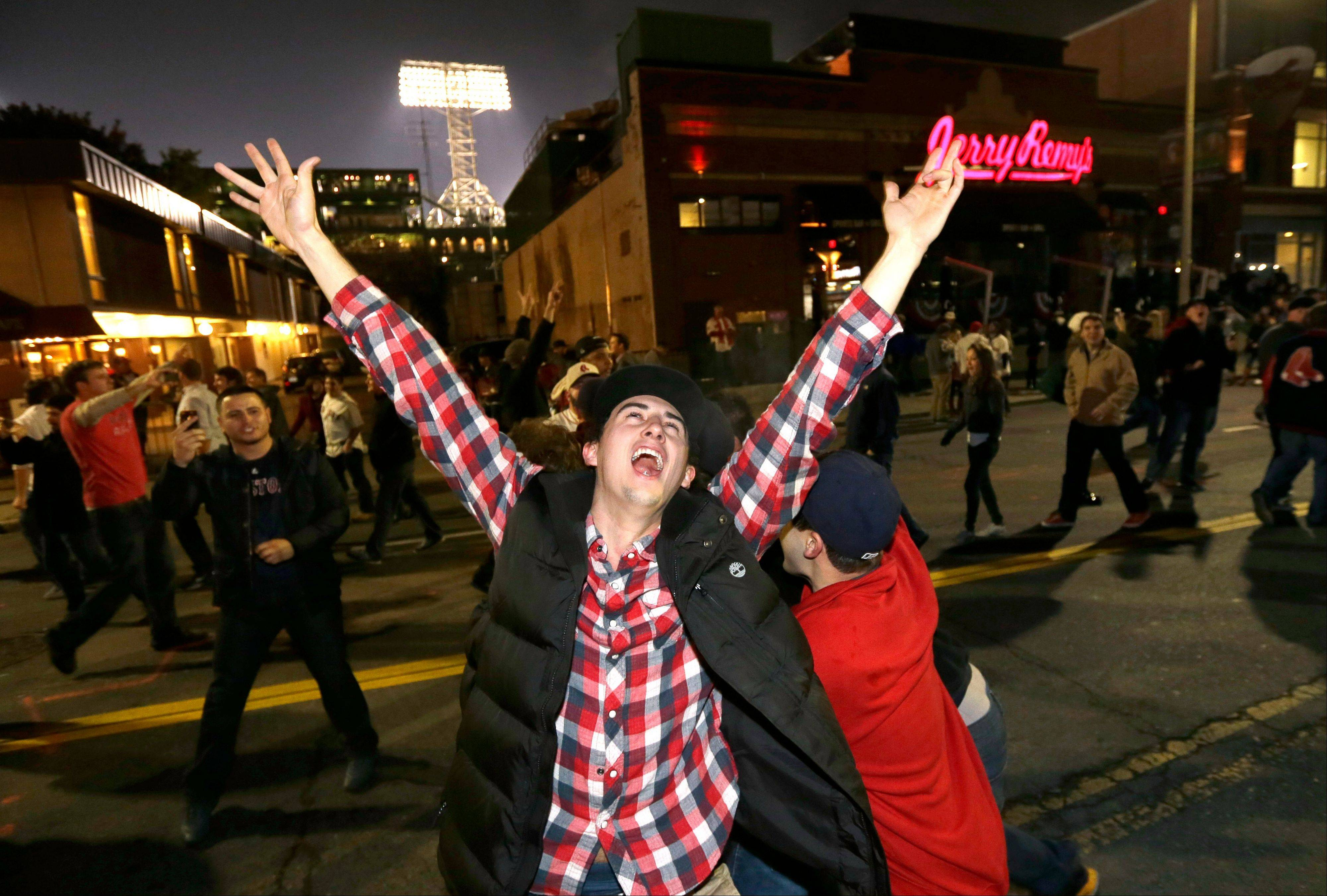 Boston Red Sox fans celebrate in the street near Fenway Park on Wednesday night after Game 6.