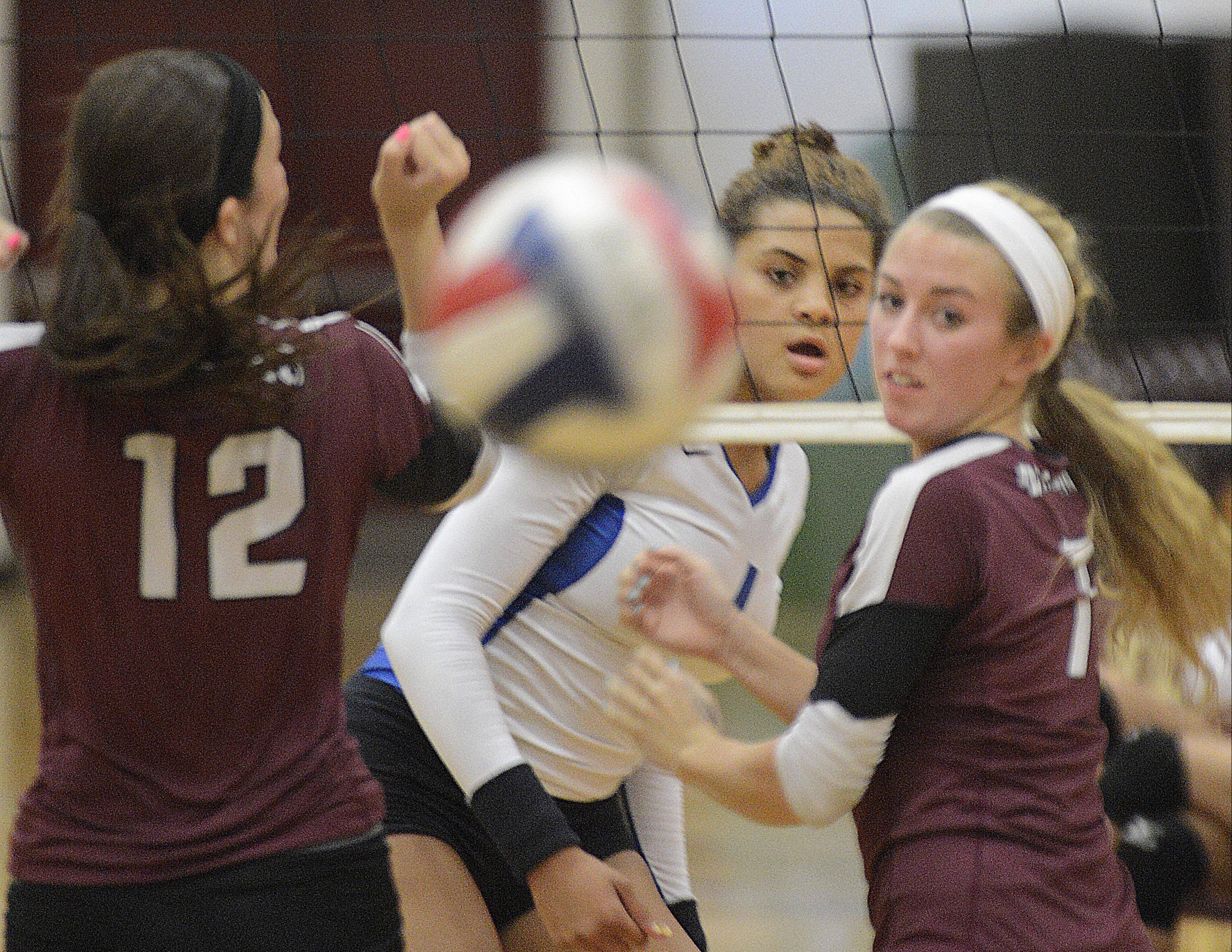 Larkin's Olivia Kofie watches her spike go past Elgin's Emma Sirridge and Nikki Zimmer earlier this season. Kofie is the honorary captain of the 2013 Daily Herald Fox Valley All-Area team.
