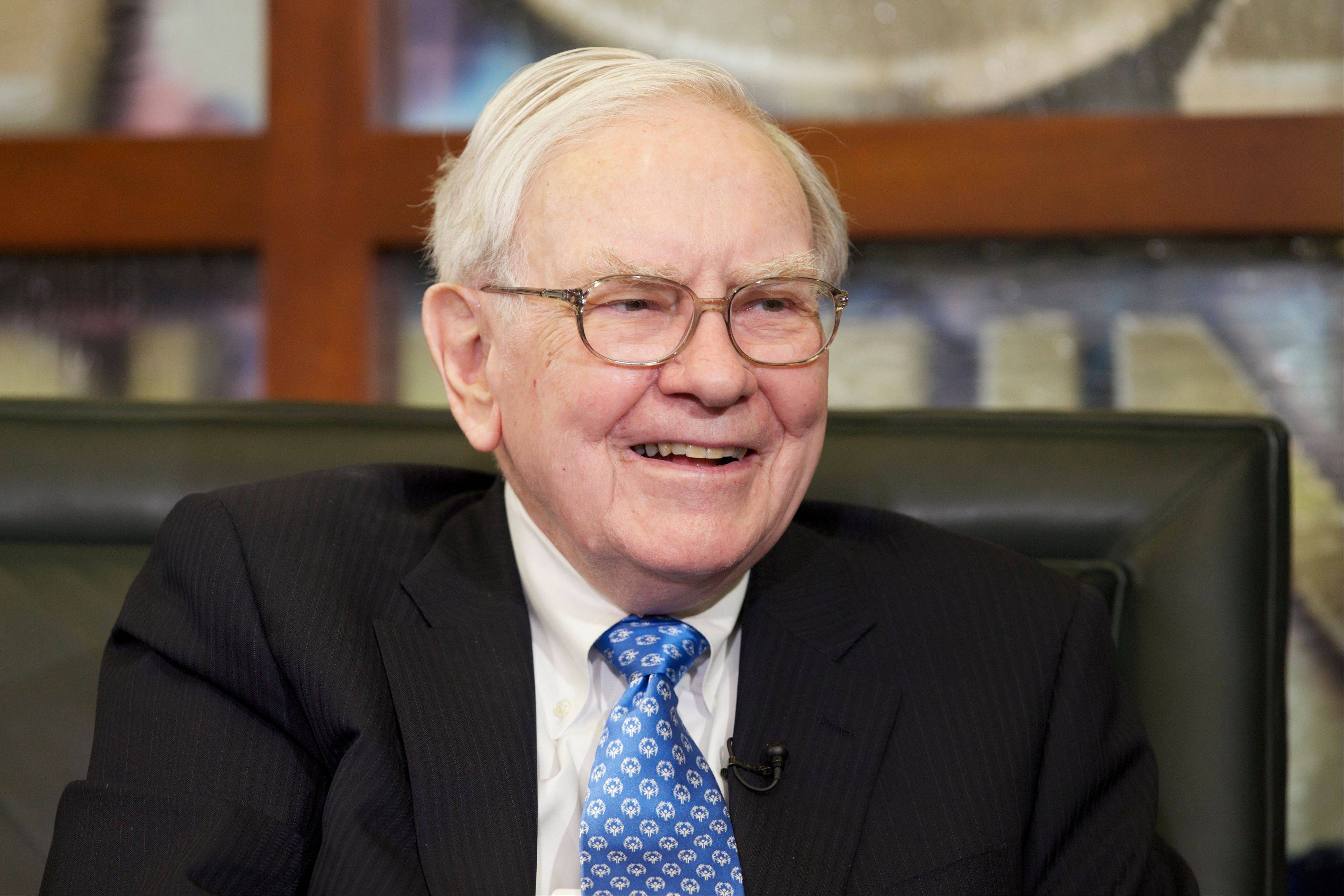 Associated Press/May 6, 2013 Warren Buffett smiles during an interview with Liz Claman of the Fox Business Network in Omaha, Neb. The Berkshire Hathaway company reported quarterly earnings on Friday.