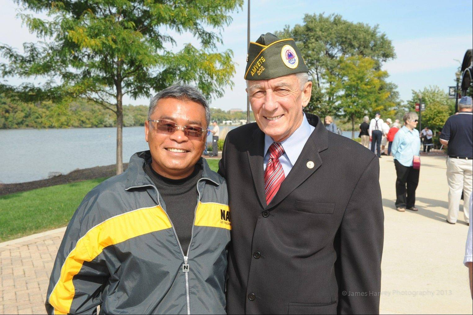 Chin Keomuongchanh, left, poses with state Rep. Keith Farnham at the Elgin Veterans Memorial Park. Keomuongchanh is working with Elgin and state officials to provide greater recognition for Lao veterans who assisted the United States during the Vietnam War.