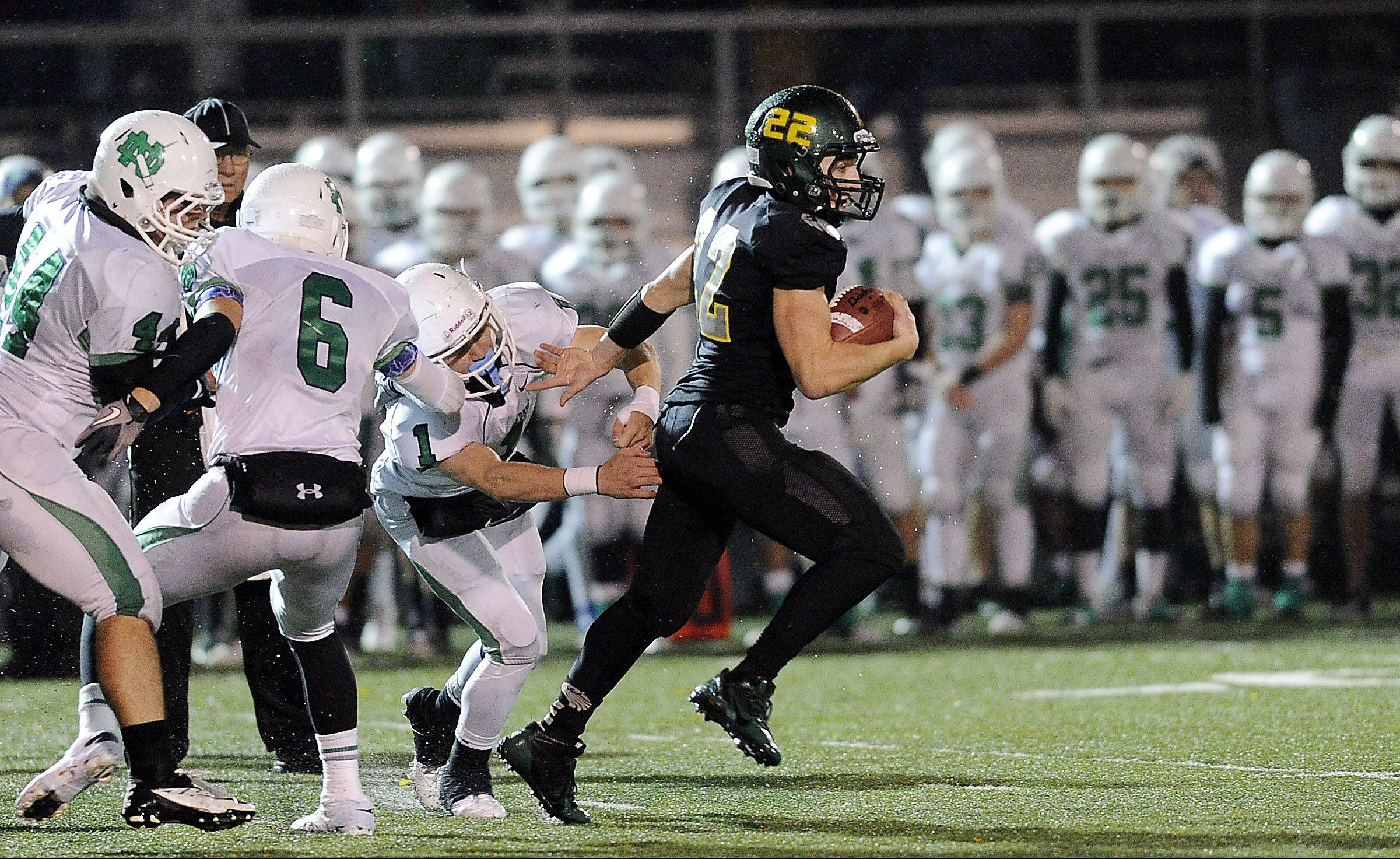 Fremd�s Garrett Groot scrambles for a 44-yard run in the second quarter against Notre Dame in Class 8A playoffs action at Fremd on Friday.
