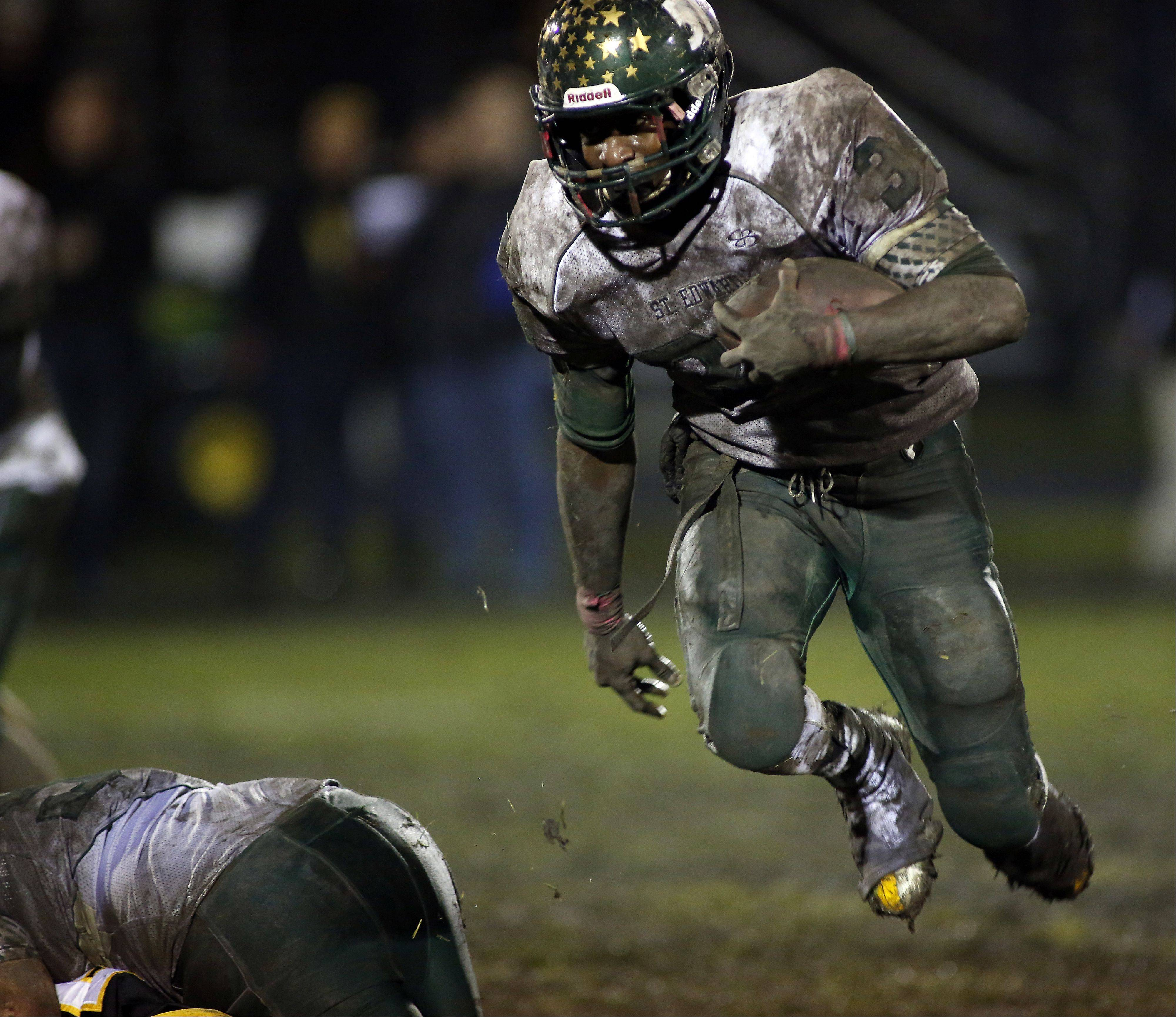 St. Edward�s Davontae Elam (34) moves upfield against Harvard during the IHSA Class 4A playoff game Friday in Harvard. Elam finished his St. Edward career as the program�s all-time leading rusher.