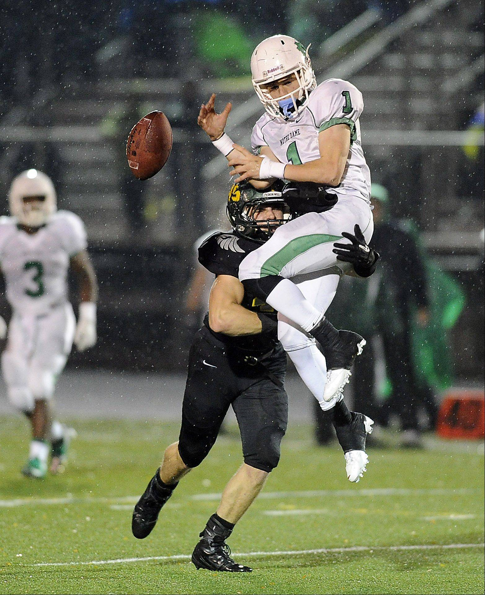Fremd�s Stephen Walsh breaks up a pass play against Notre Dame�s Pat Cravens in the first half.