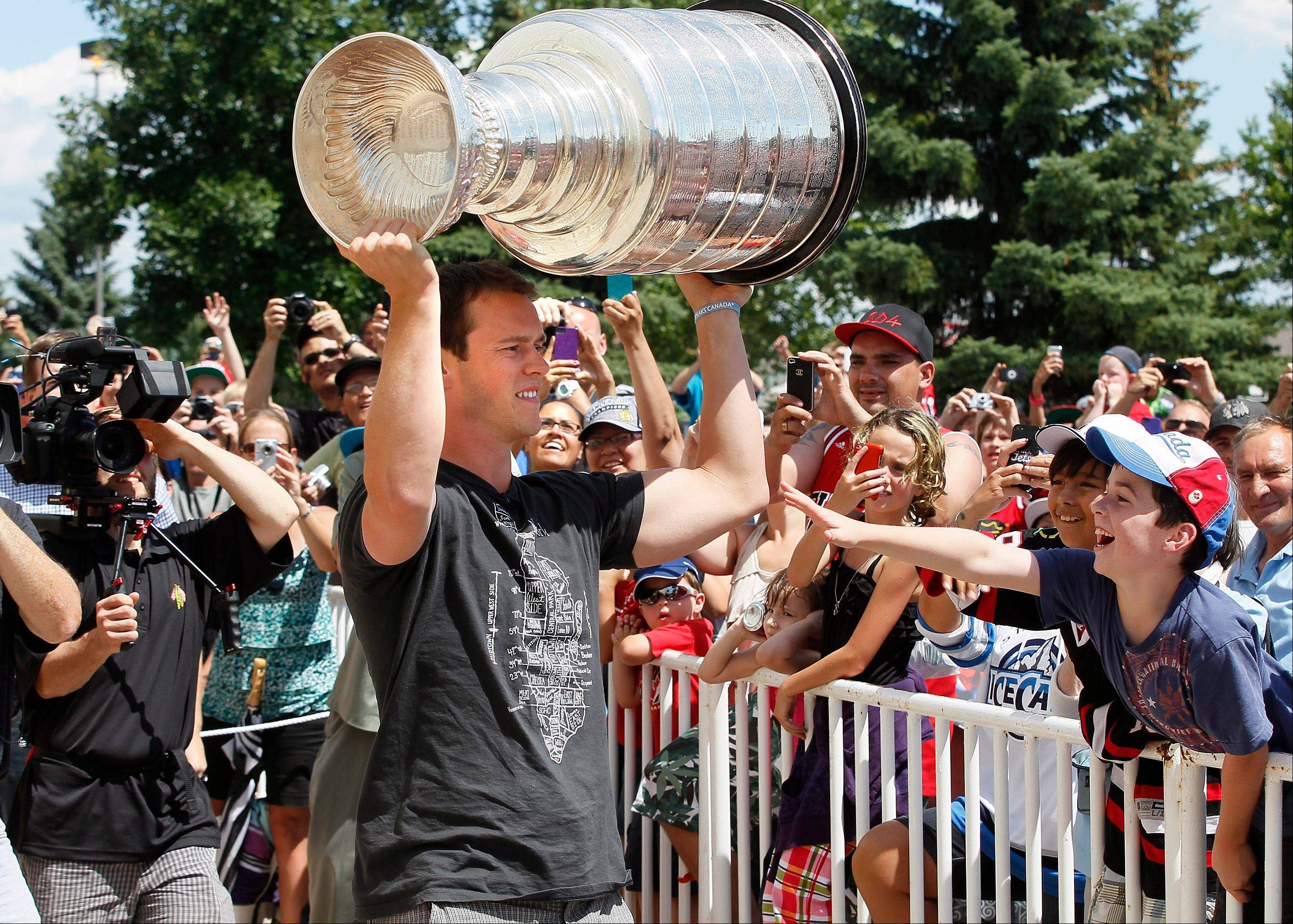 Chicago Blackhawks captain Jonathan Toews brought the Stanley Cup last July 19th to the Jonathan Toews Community Centre in Winnipeg, Manitoba, his hometown. On Saturday, he's bringing the rest of the Blackhawks to play the Jets, the team he cheered as a young boy.