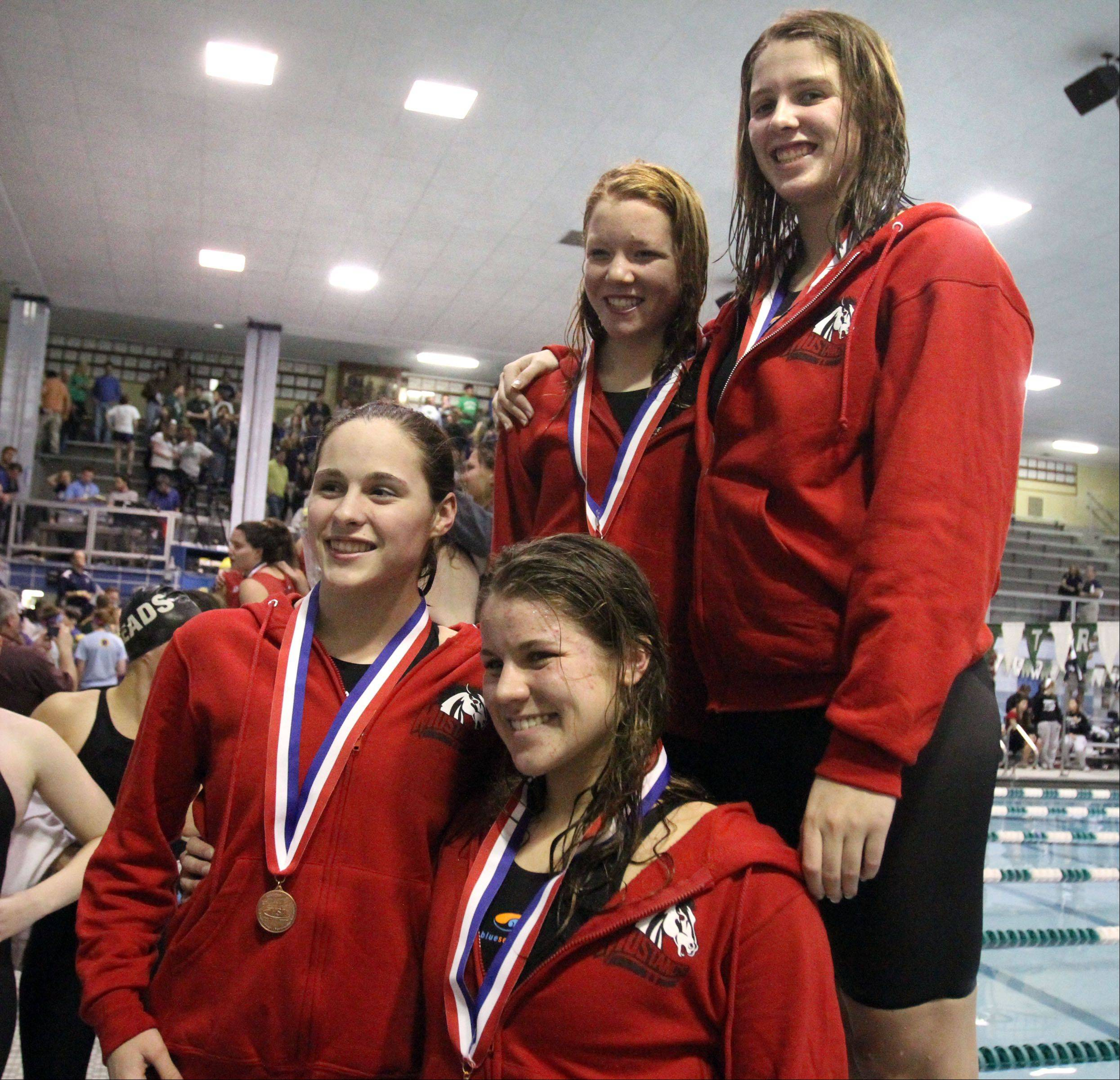 Mundelein�s Karrie Kozokar, right, will swim the 100-yard freestyle in the state series.She�s pictured here at state last year with, from left, Amy Klink, Jennifer Kordik and Erin Falconer after they placed eighth in the 400 freestyle relay.