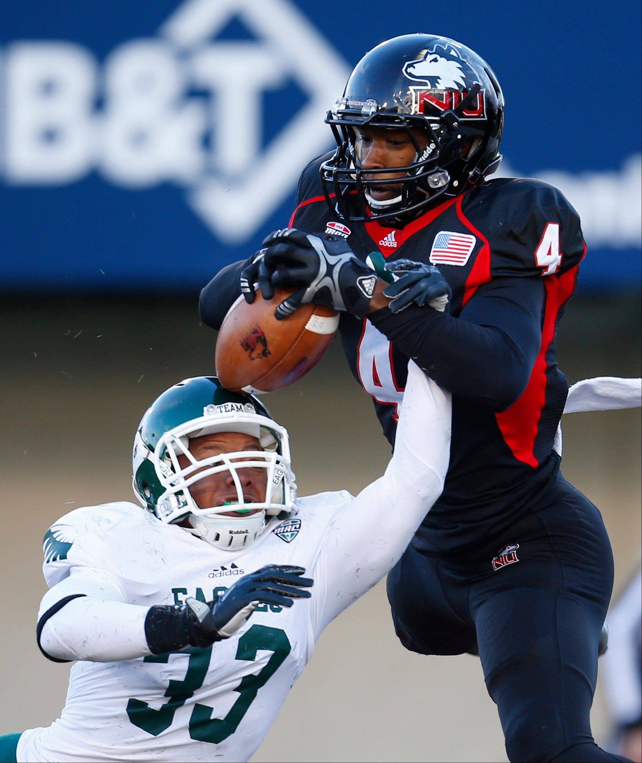 NIU wide receiver Da�Ron Brown catches a touchdown pass off the head of Eastern Michigan defensive back Quan Pace during the second half of last Saturday�s game in DeKalb.