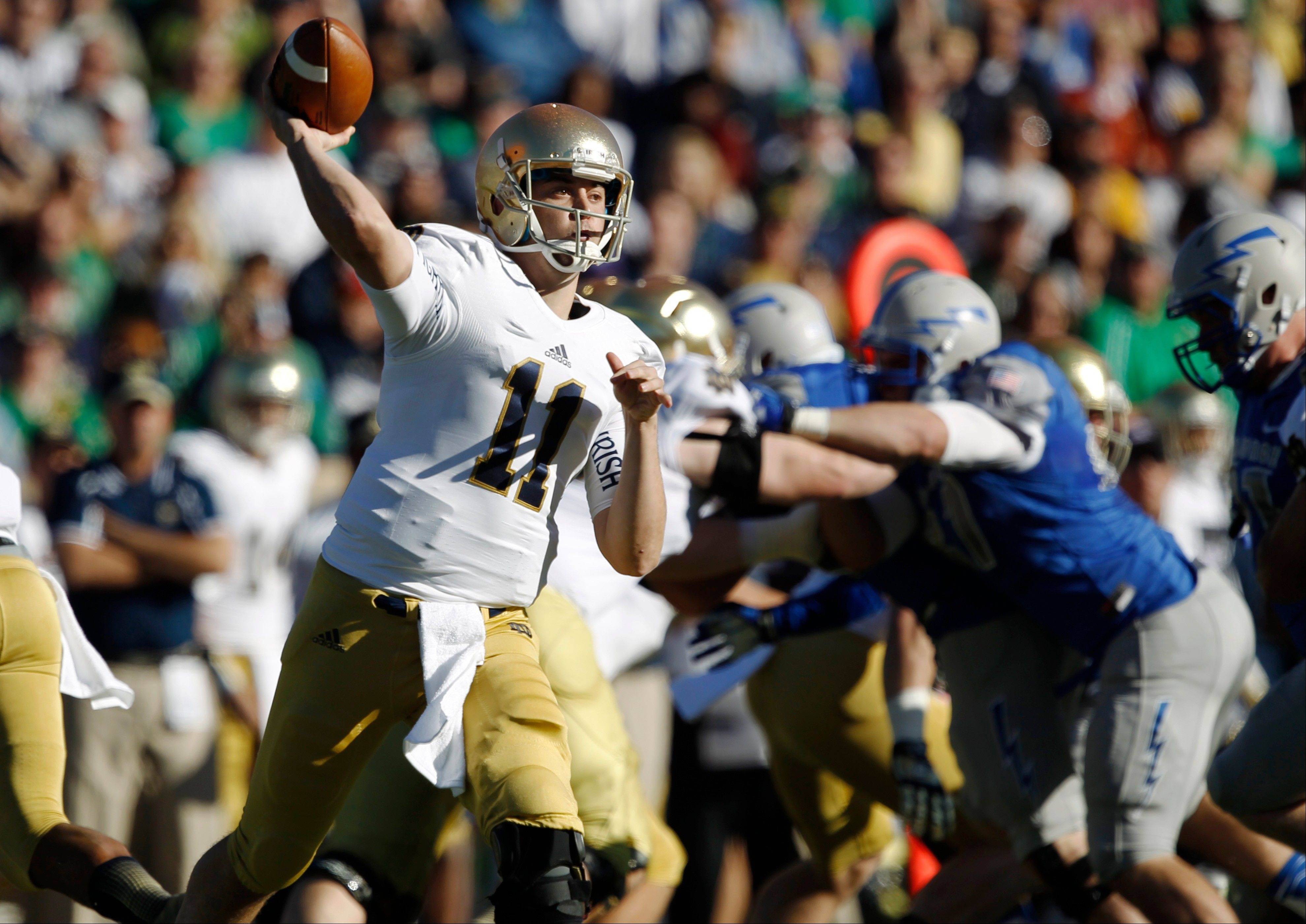 Notre Dame quarterback Tommy Rees passes against Air Force during Saturday�s road win. With Notre Dame (6-2) trying to make a push for a BCS bowl berth, Rees seems to have regained his touch.