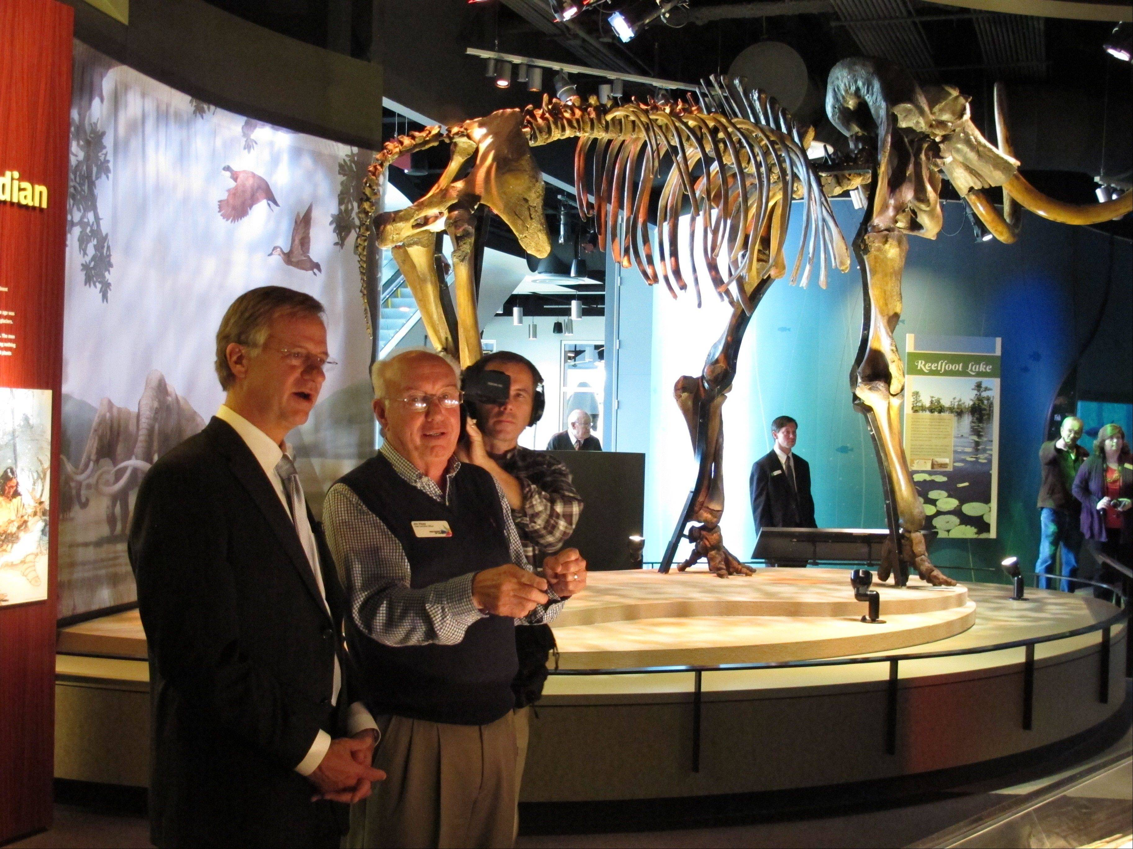 Tennessee Gov. Bill Haslam, left, and Discovery Park of America CEO Jim Rippy look at exhibits during a tour of the new museum and educational venue.