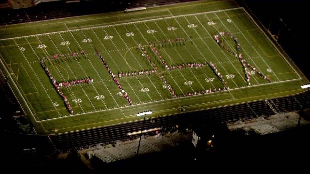 Students spell FHS on the football field.