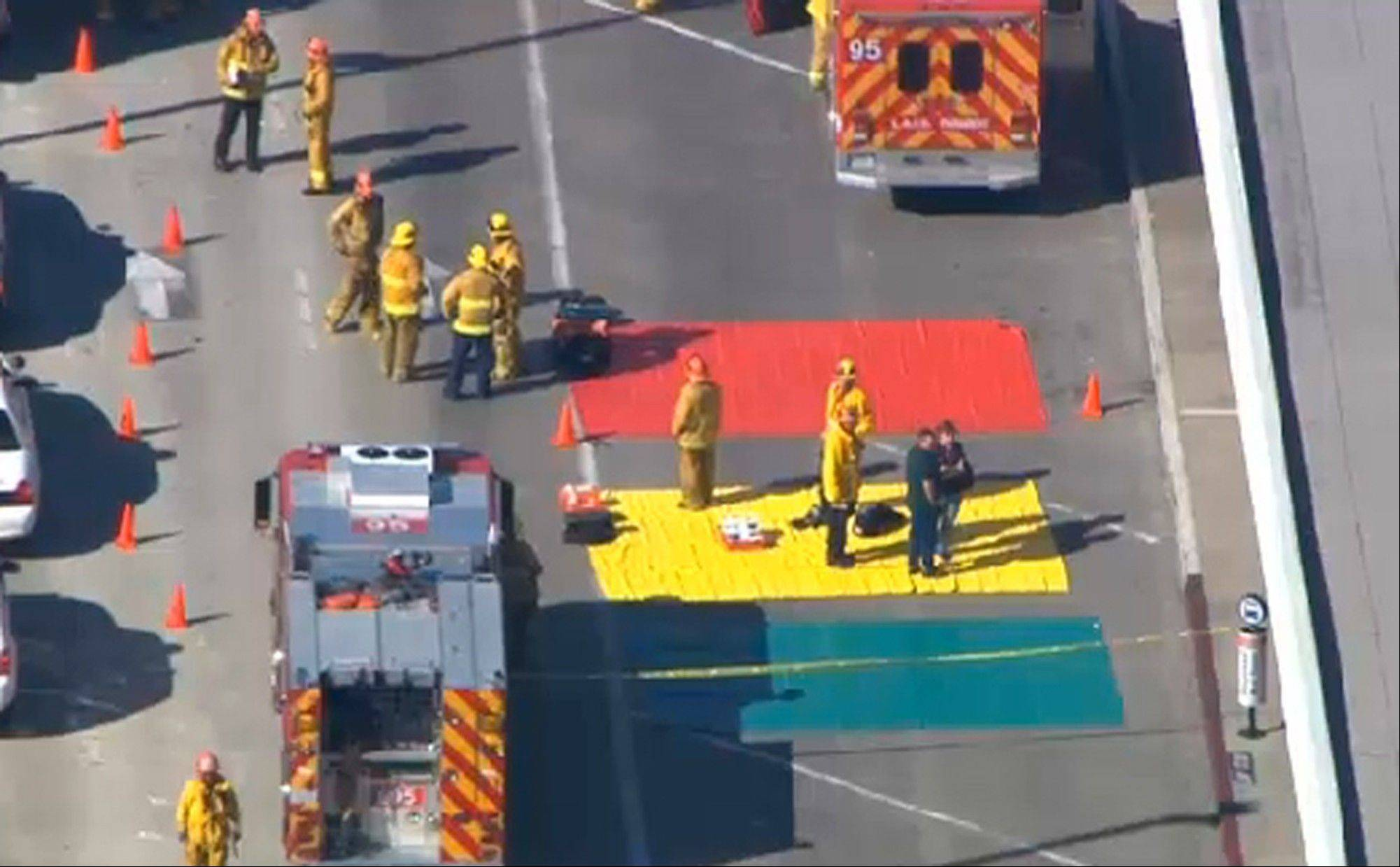In this aerial video frame grab provided by CBS-LA, fire and rescue personnel gather at Los Angeles International Airport on Friday Nov. 1, 2013. Shots were fired Friday at Los Angeles International Airport, prompting authorities to evacuate a terminal and stop flights headed for the city from taking off from other airports.