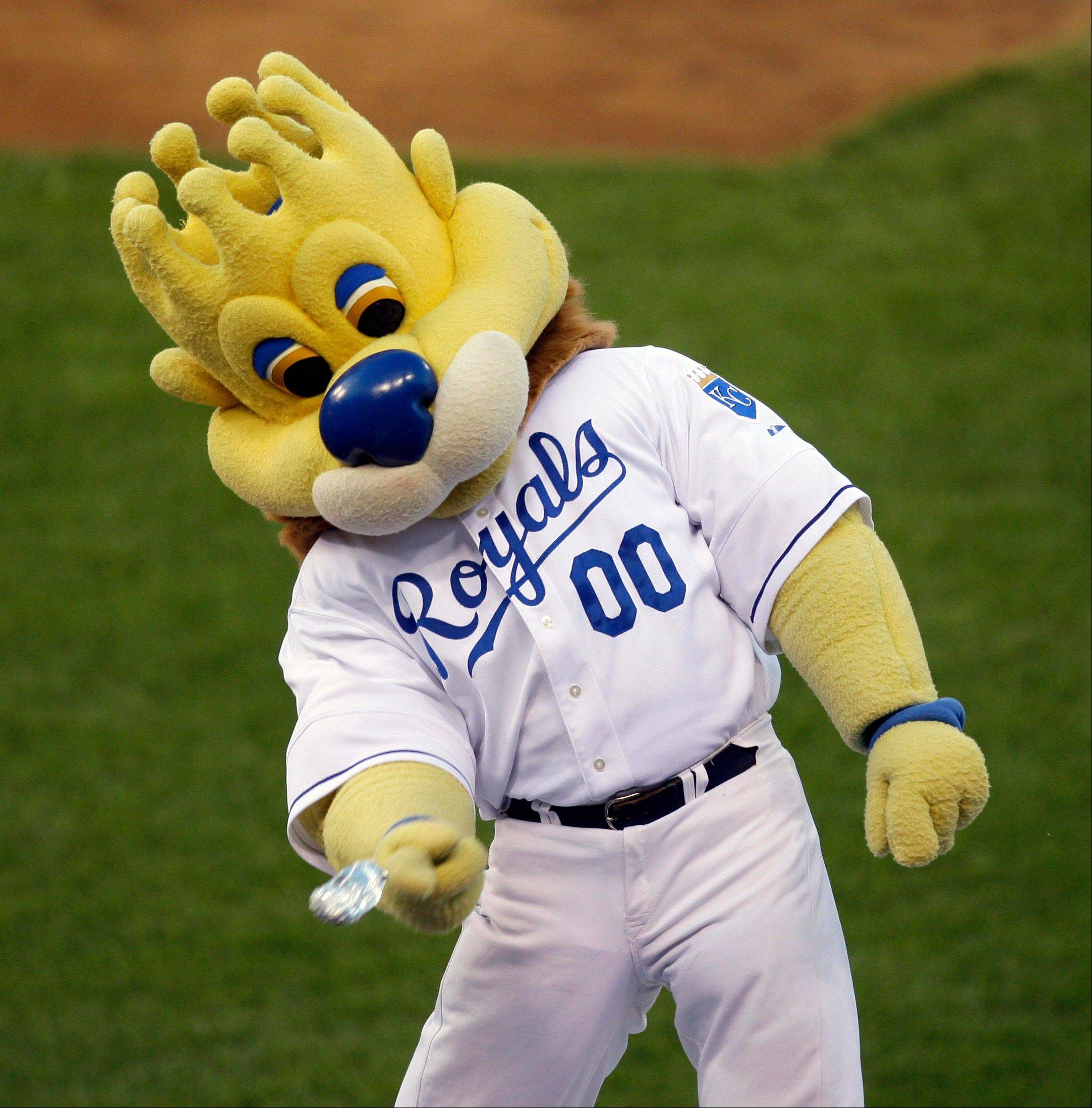 "Kansas City Royals mascot ""Sluggerrr"" throws hot dogs into the crowd. The Missouri Supreme Court is weighing whether a legal standard that protects sports teams from being sued over fan injuries caused by in-game events should also apply to those caused by mascots or other team personnel."