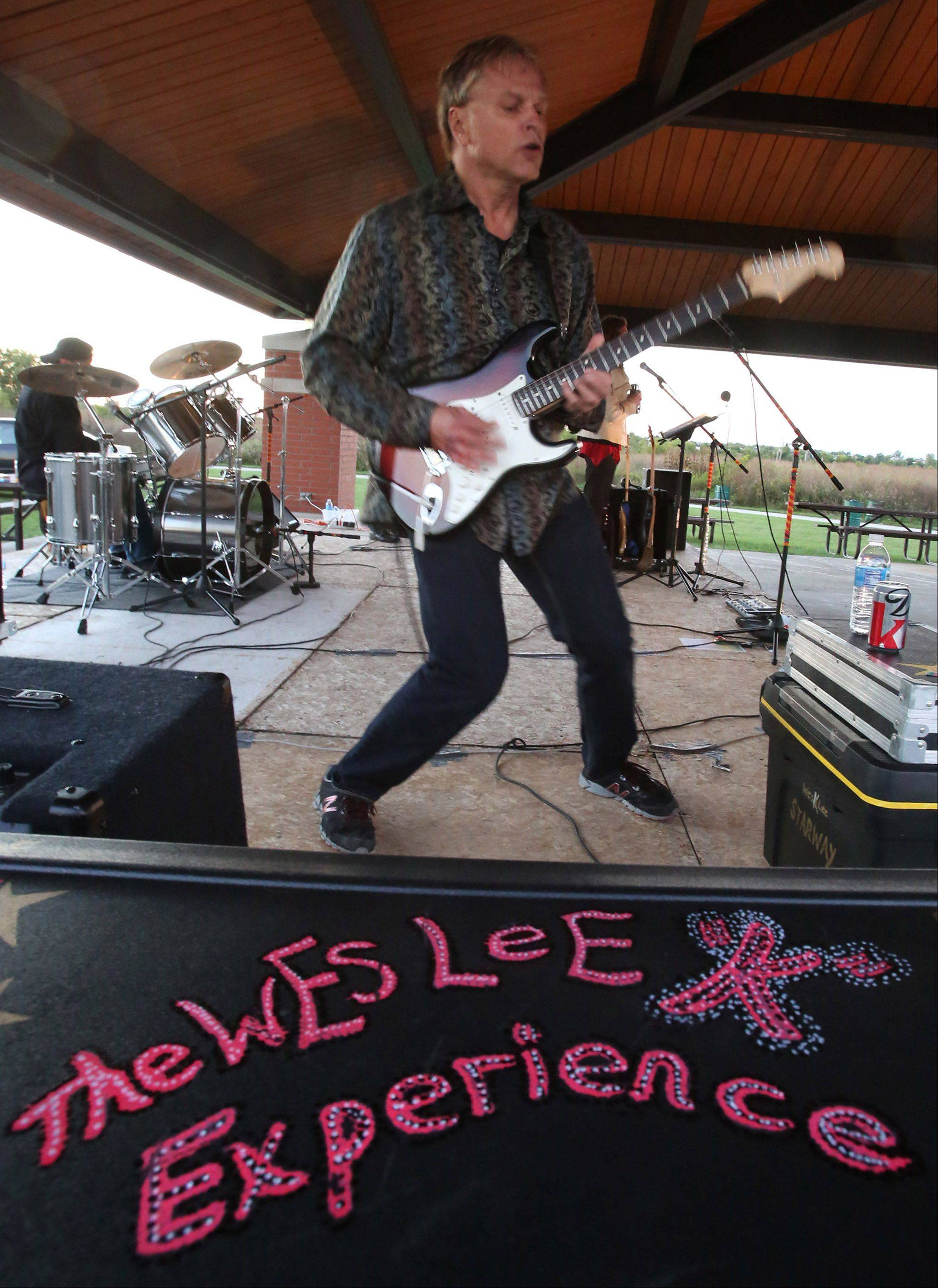 "Wesley Kochan of Bartlett performs as Wes Lee ""K"" and The Third Wheel, outdoors at the Bartlett Nature Center in September."