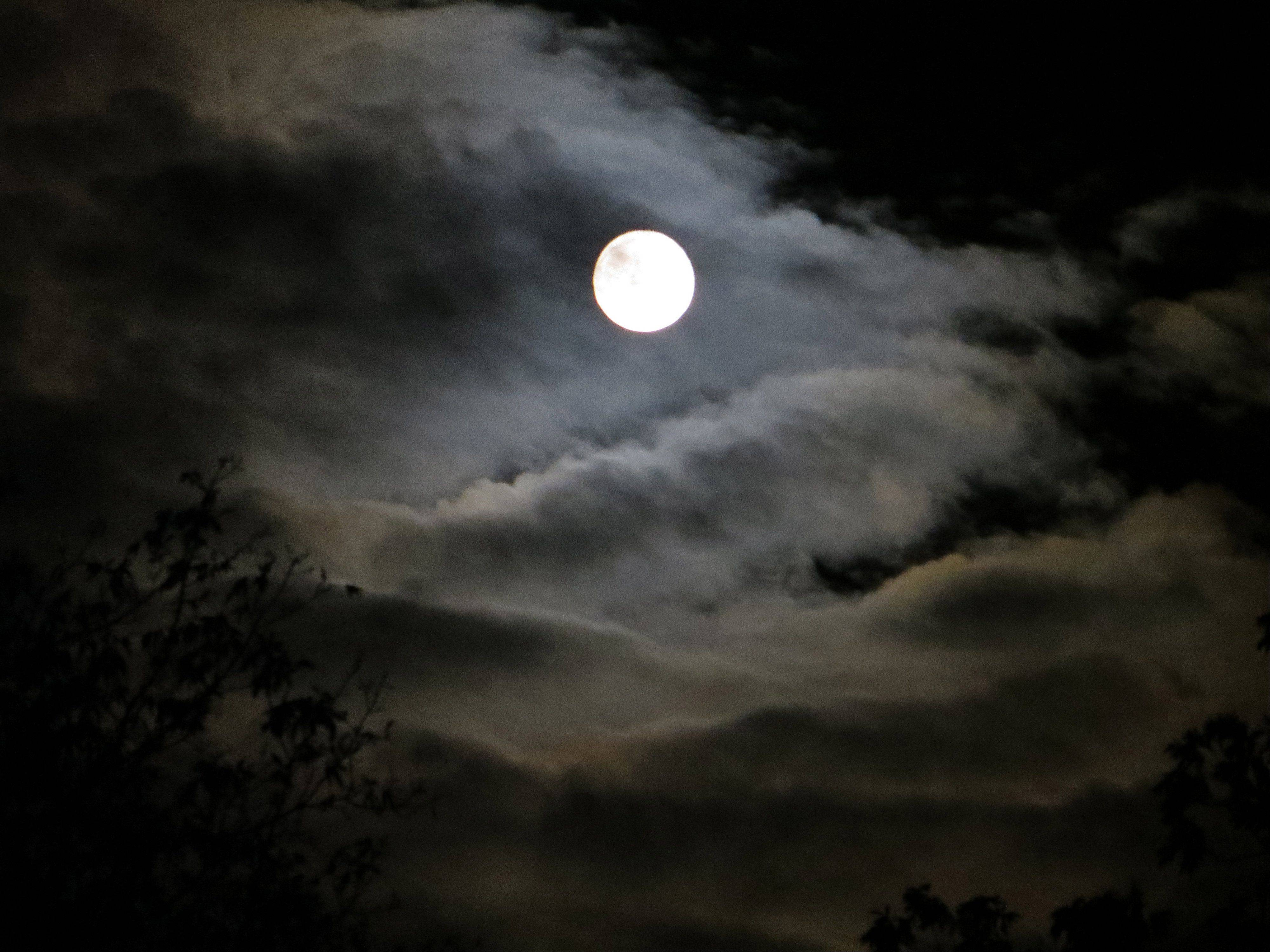 The clouds revolved around the full moon as seen from a Rolling Meadows deck at 7:11 p.m. on October 19th.