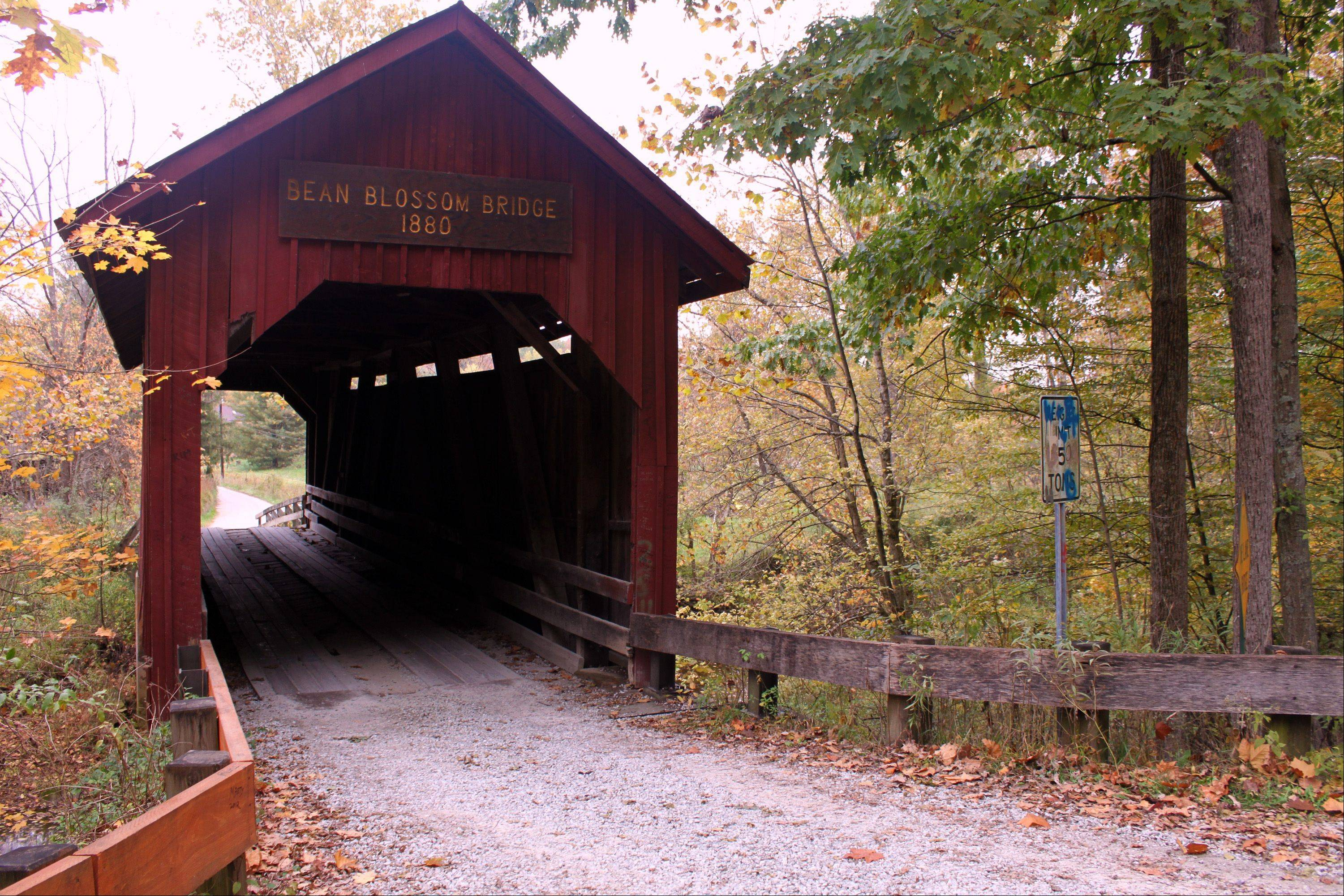 The photo of this rustic covered bridge was taken in Bean Blossom, IN. in the scenic Brown County Indiana. It just seemed to capture the beauty of the season's fall colors and also provided a link to seasons past.