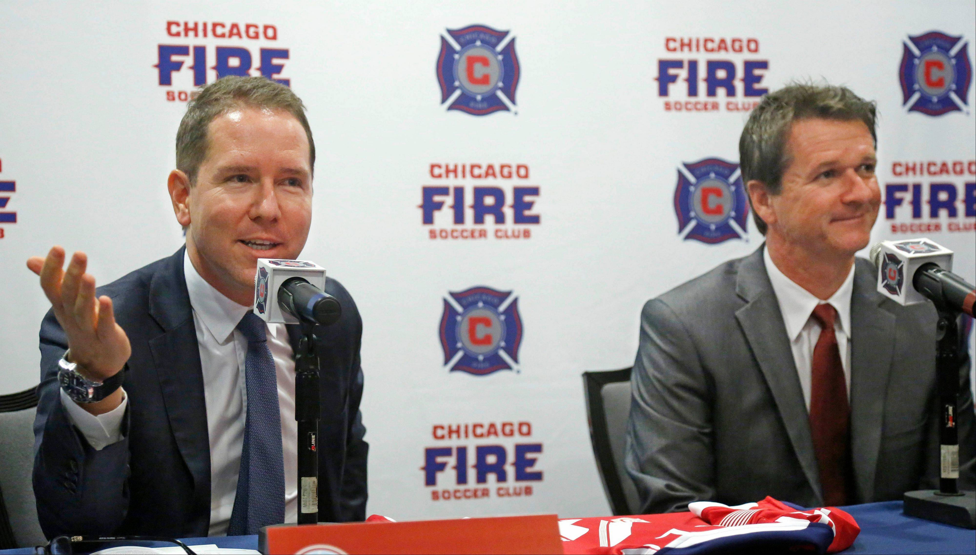 Chicago Fire owner Andrew Hauptman, left, introduces Frank Yallop as the new head coach and director of soccer of the MLS soccer club during a news conference, Thursday, Oct. 31, 2013, in Chicago.