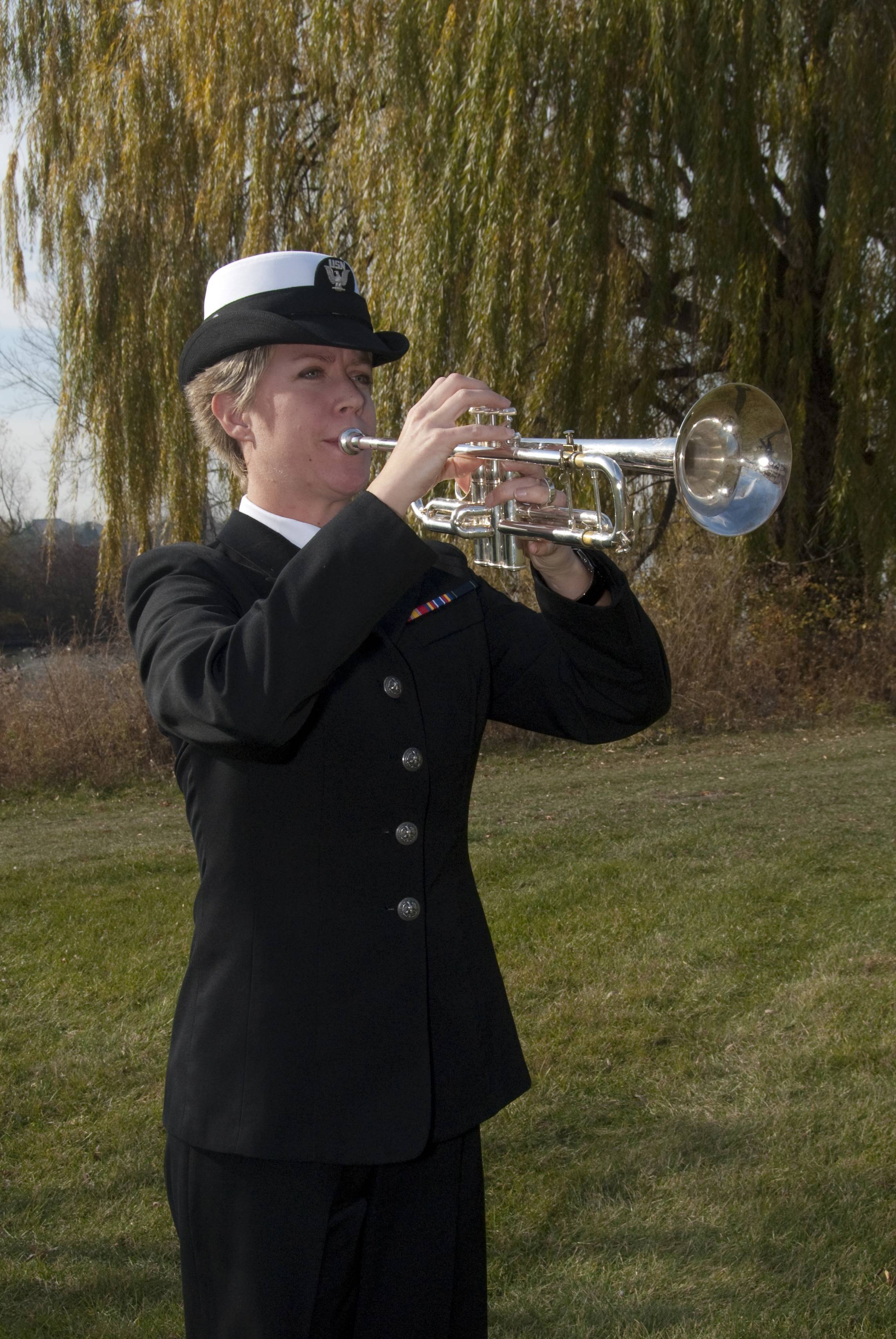 "A Navy bugler plays ""Taps"" at a past CLC Veterans Day ceremony."