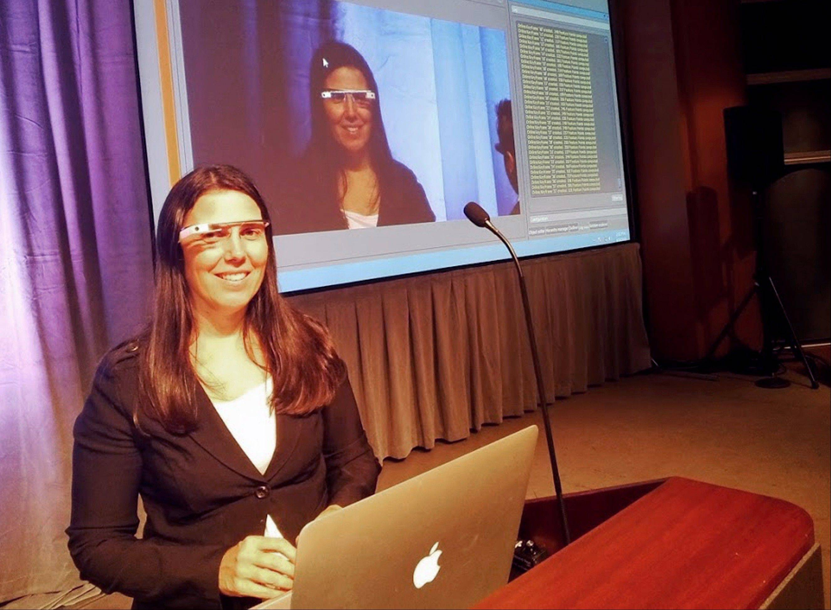 This undated photo released courtesy Cecilia Abadie shows Cecilia Abadie a software developer from Temecula, Calif., during a presentation. Abadie was pulled over for speeding on Tuesday Oct. 29, 2013, in San Diego, when a California Highway Patrol officer noticed she was wearing Google Glass and tacked on a citation usually given to drivers who may be distracted by a video or TV screen.