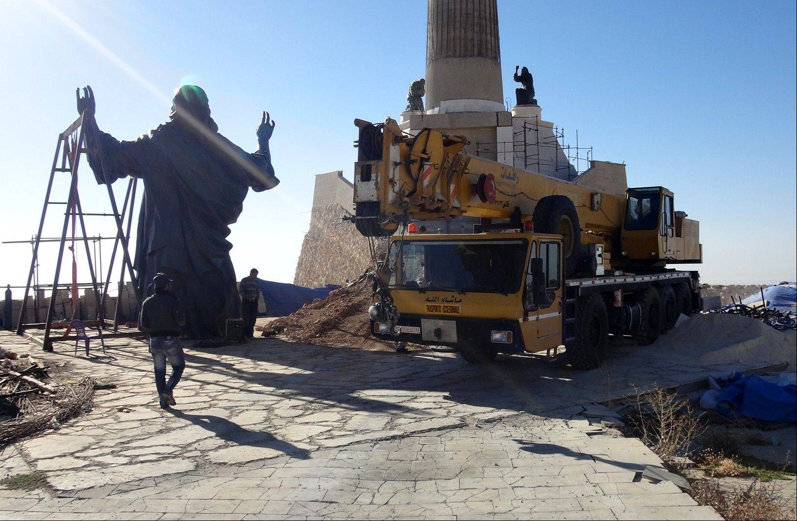 Workers prepare to install a statue of Jesus on Mount Sednaya, Syria.