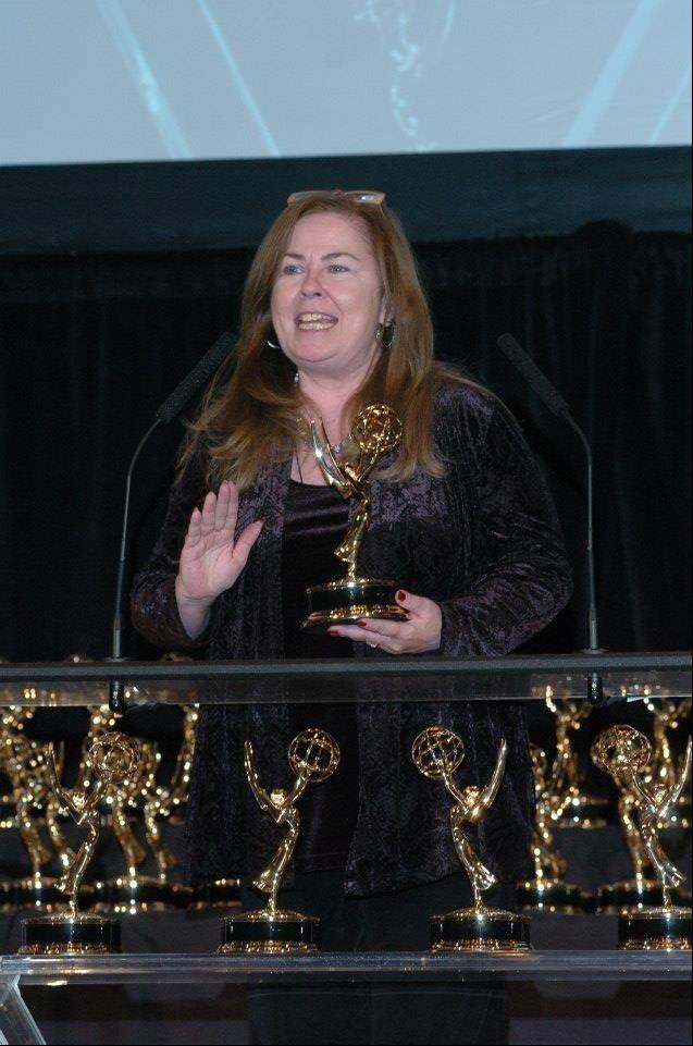 Carol Cooling-Kopp accepting one of her many Emmy Awards.