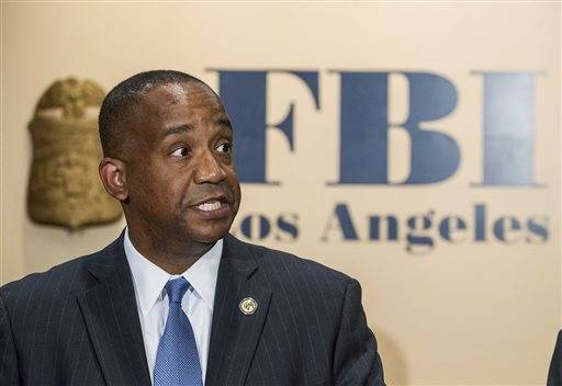 United States Attorney Andre Birotte Jr. speaks in press conference to provide an update on the investigation of the shooting incident at Los Angeles International Airport (LAX), on Saturday.