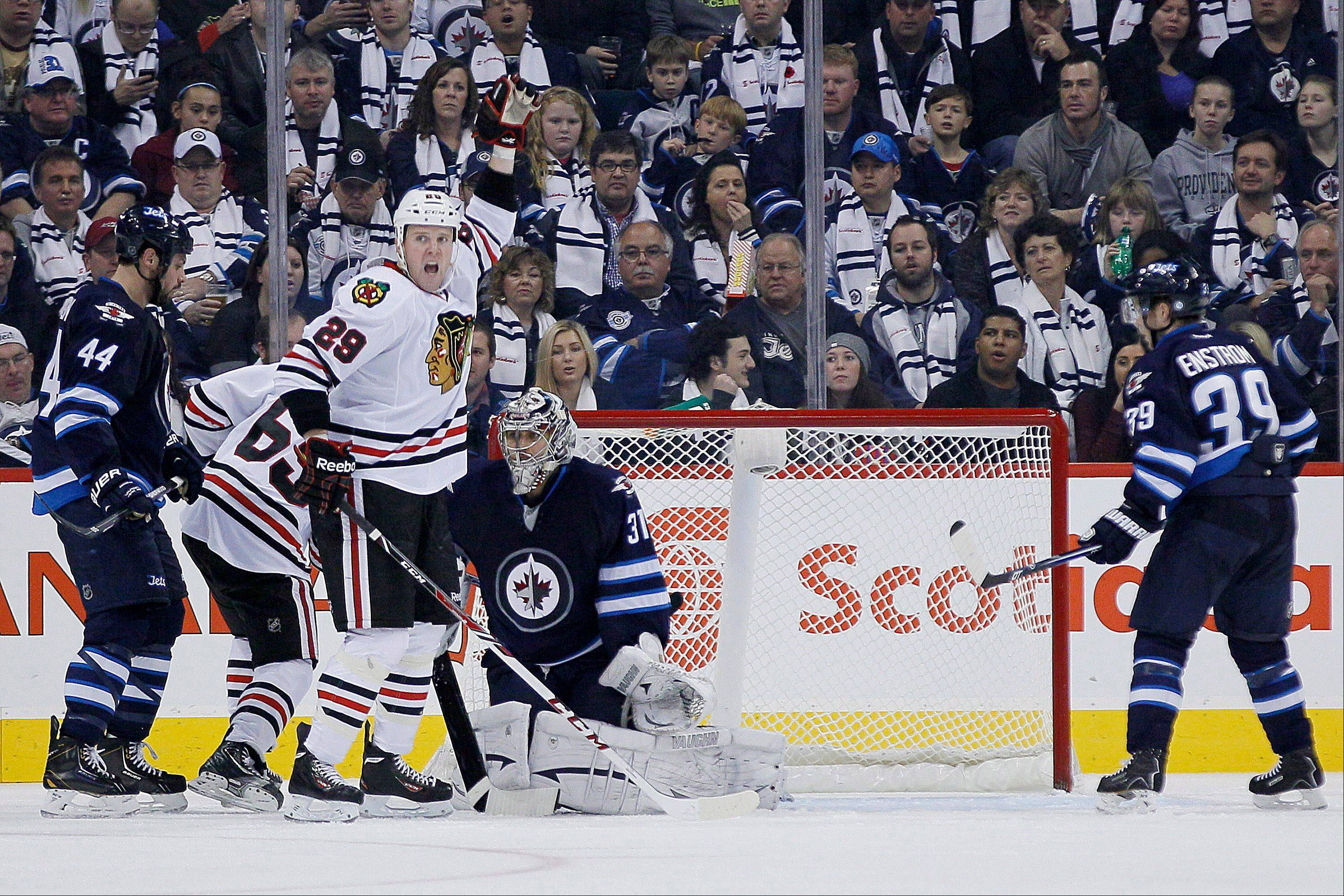 Bryan Bickell (29) celebrates Nick Leddy's (8) goal against the Winnipeg Jets during the second period of the Blackhawks' victory in Winnipeg, Manitoba, Saturday, Nov. 2, 2013.