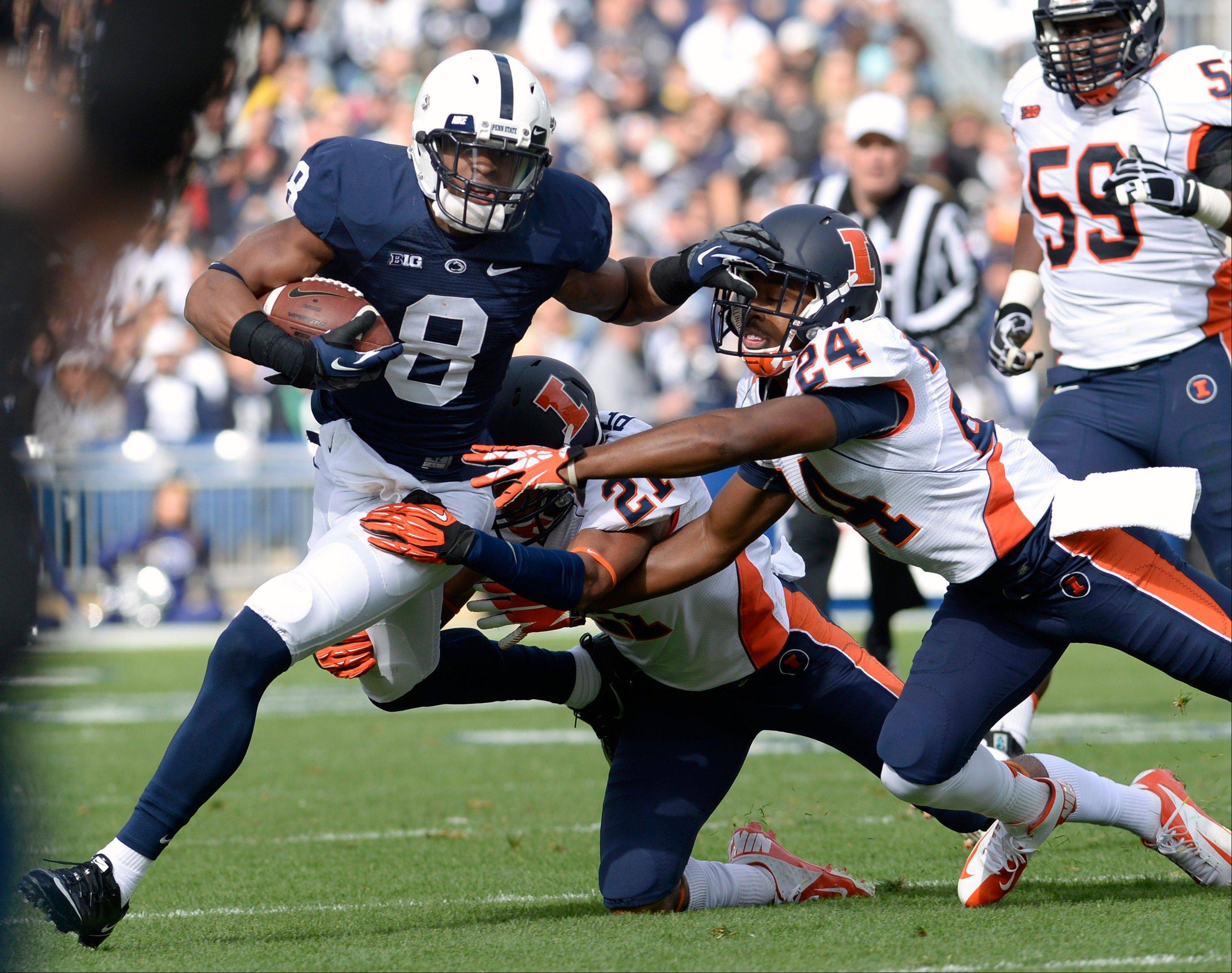 Penn State's Allen Robinson (6) tries to elude Illinois defenders Zane Petty (21) and Darius Mosely (24) in the first quarter of an NCAA college football game against Illinois in State College, Pa., Saturday, Nov. 2, 2013. (AP Photo/John Beale)